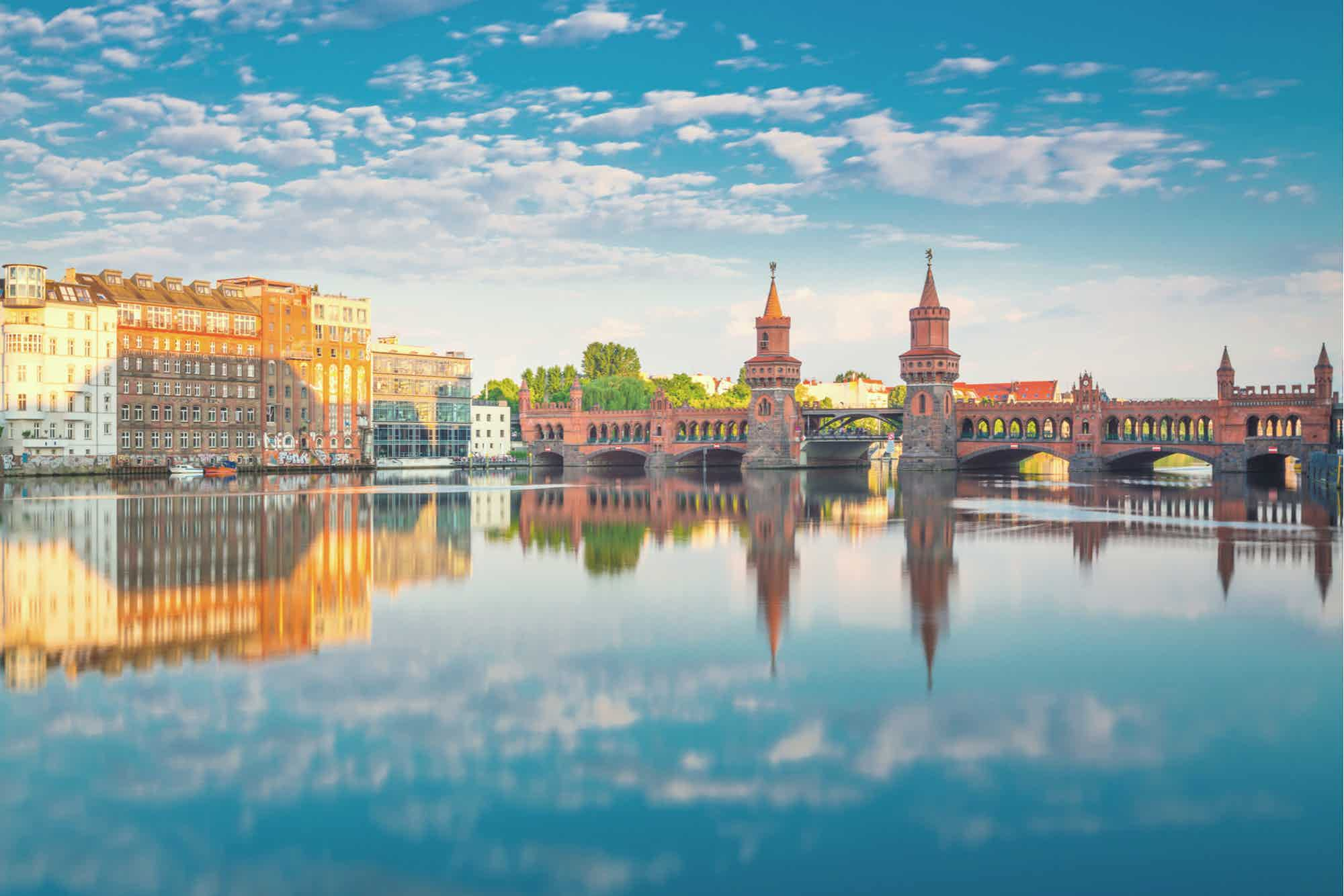 Berlin in summer time with the reflection of the clouds on the river