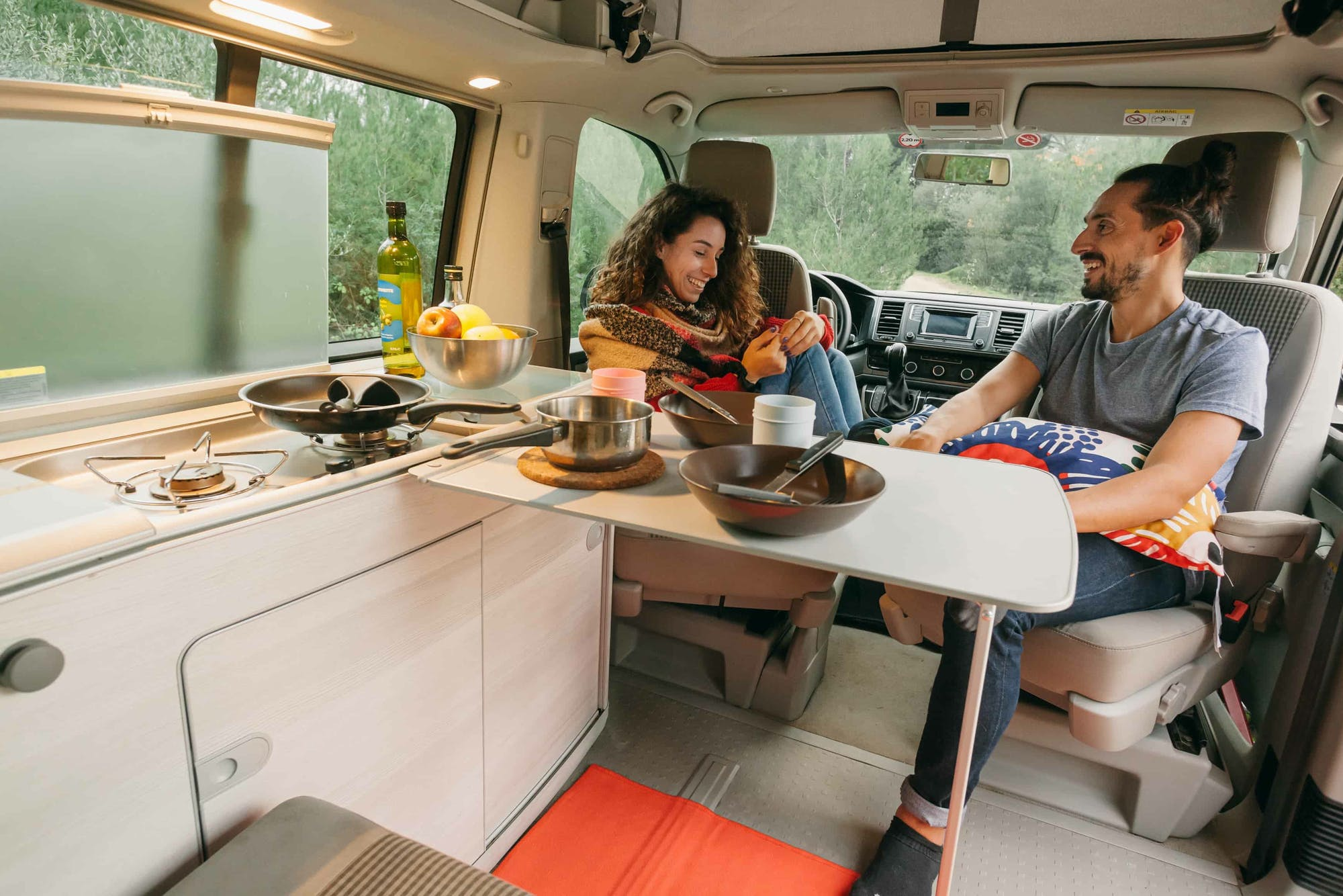 Couple sitting inside the VW California Model