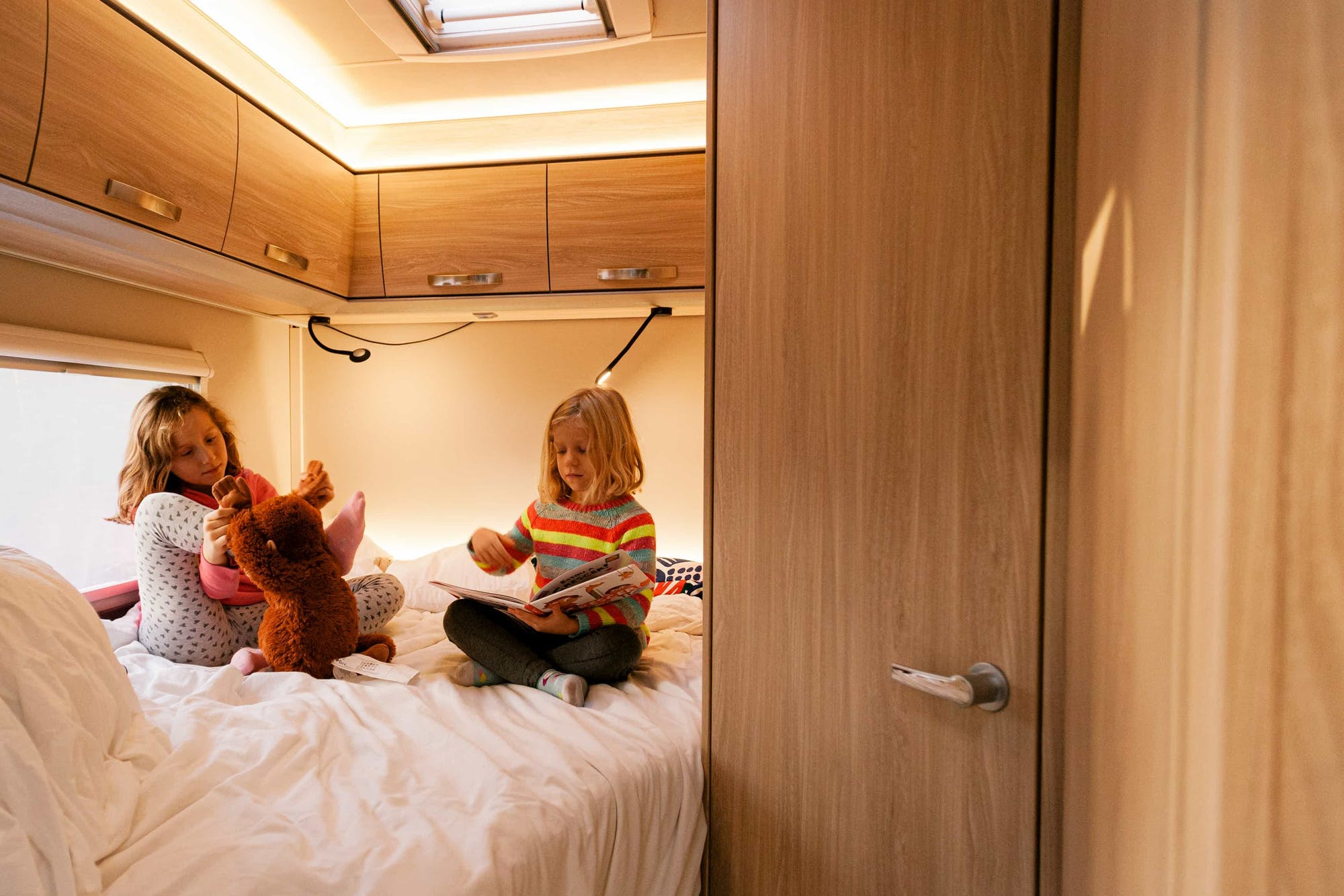 Two kids playing on the bed inside the Atlas Model