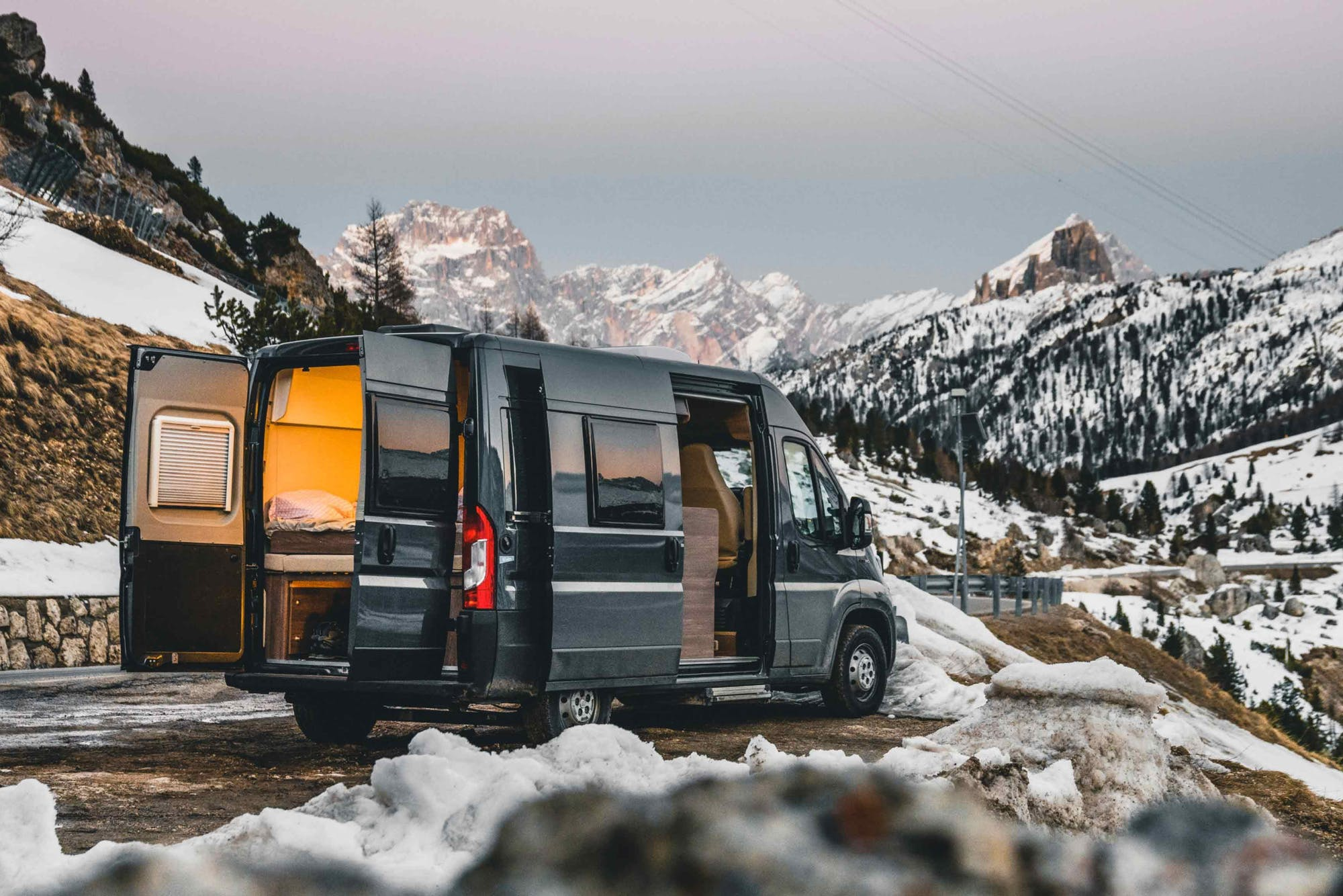 Indie Campers Nomad campervan sourrounded by snowy mountains
