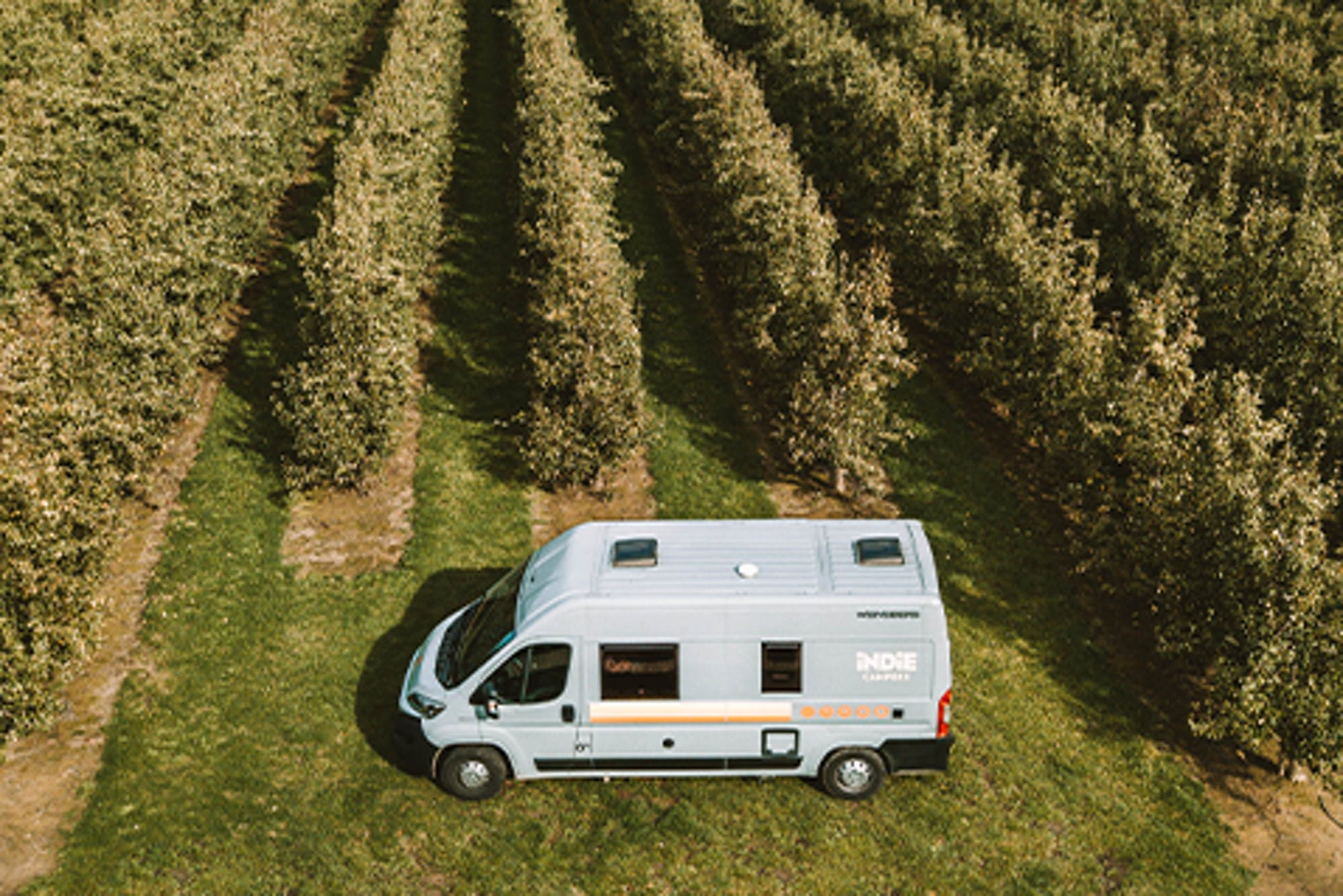 Image of a campervan parked in a field