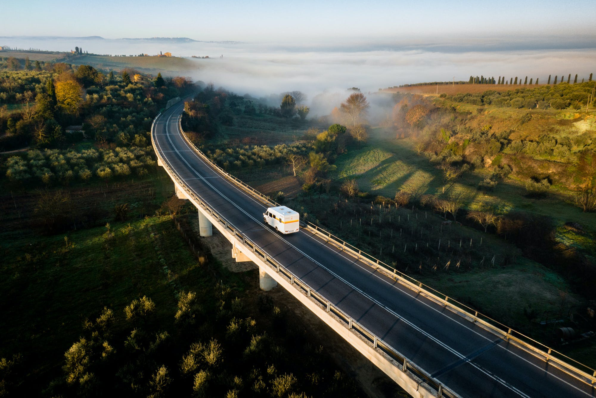 Camper van driving in a highway