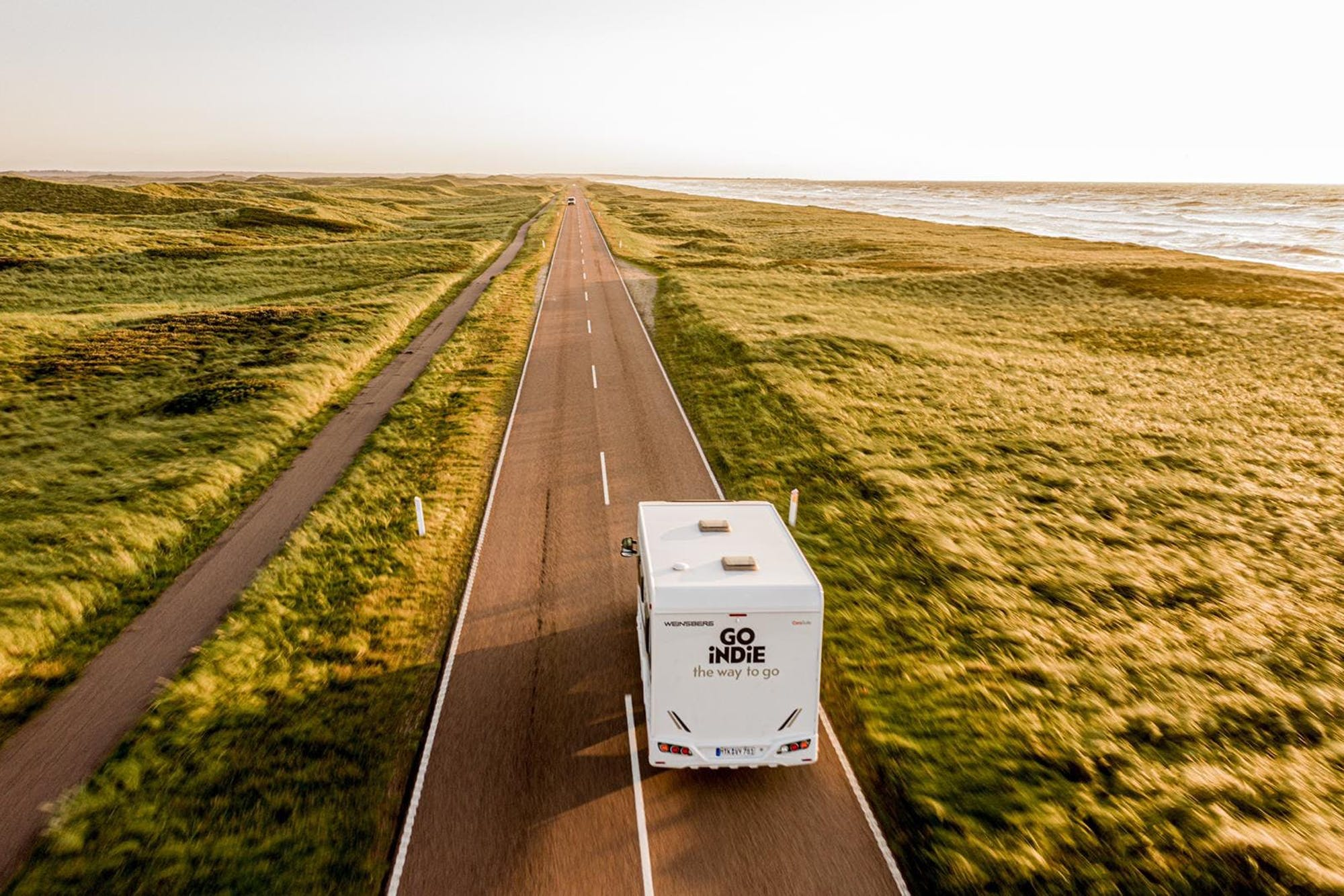 Drone view of the Atlas campervan on the road
