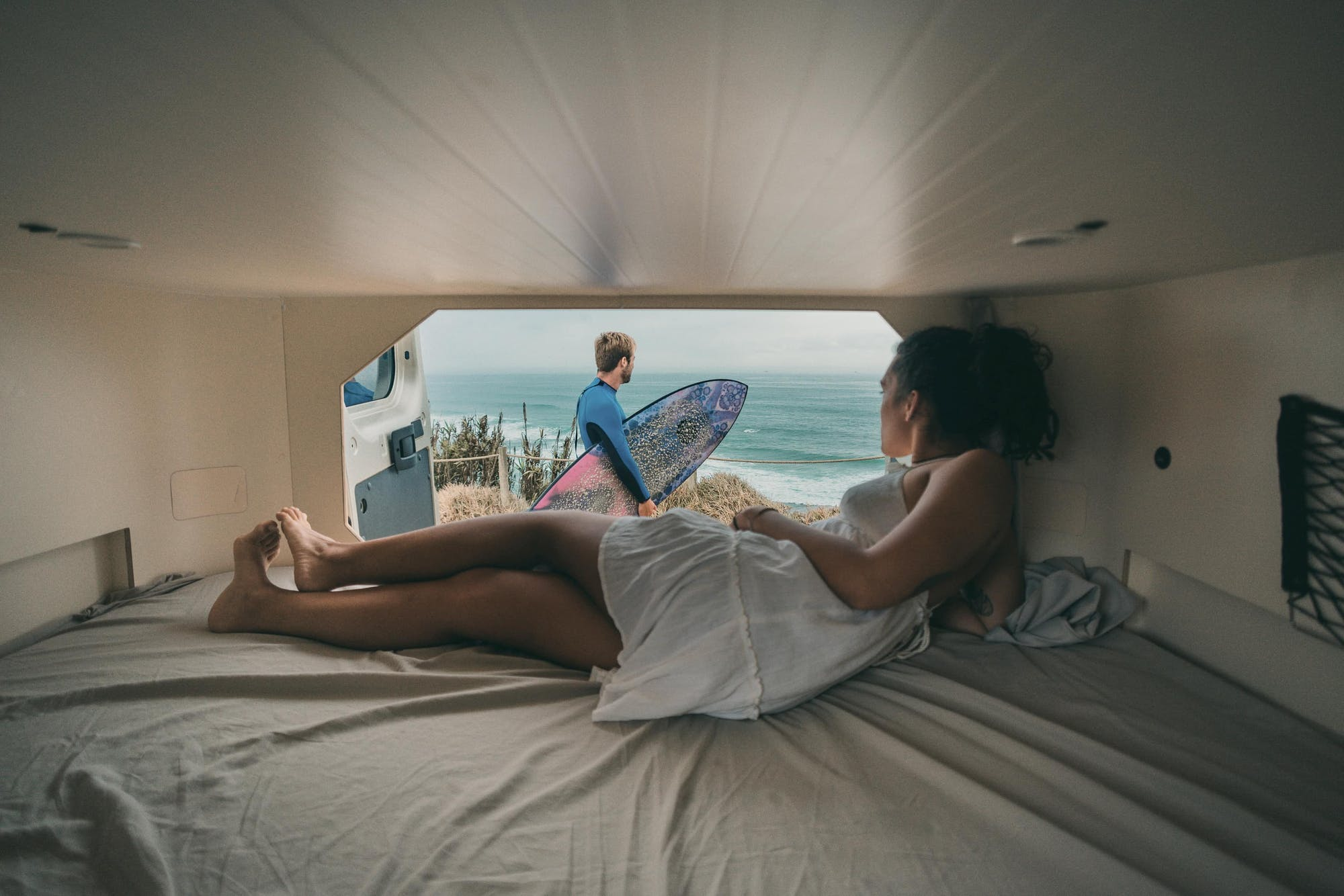 Inside view from the Active Model of a woman and a man with a surfboard