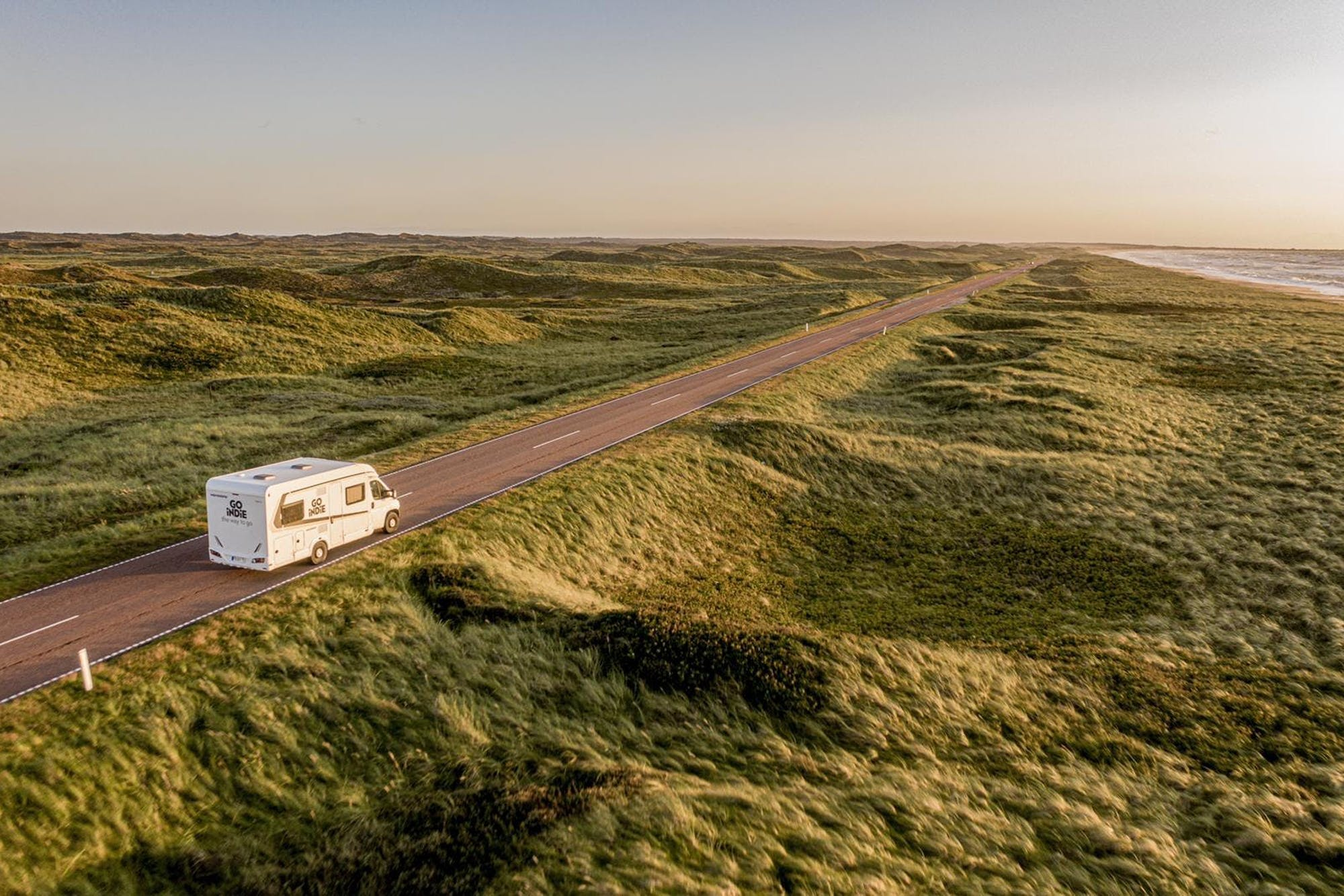 Aerial view of the Atlas campervan on a road with surrounding nature