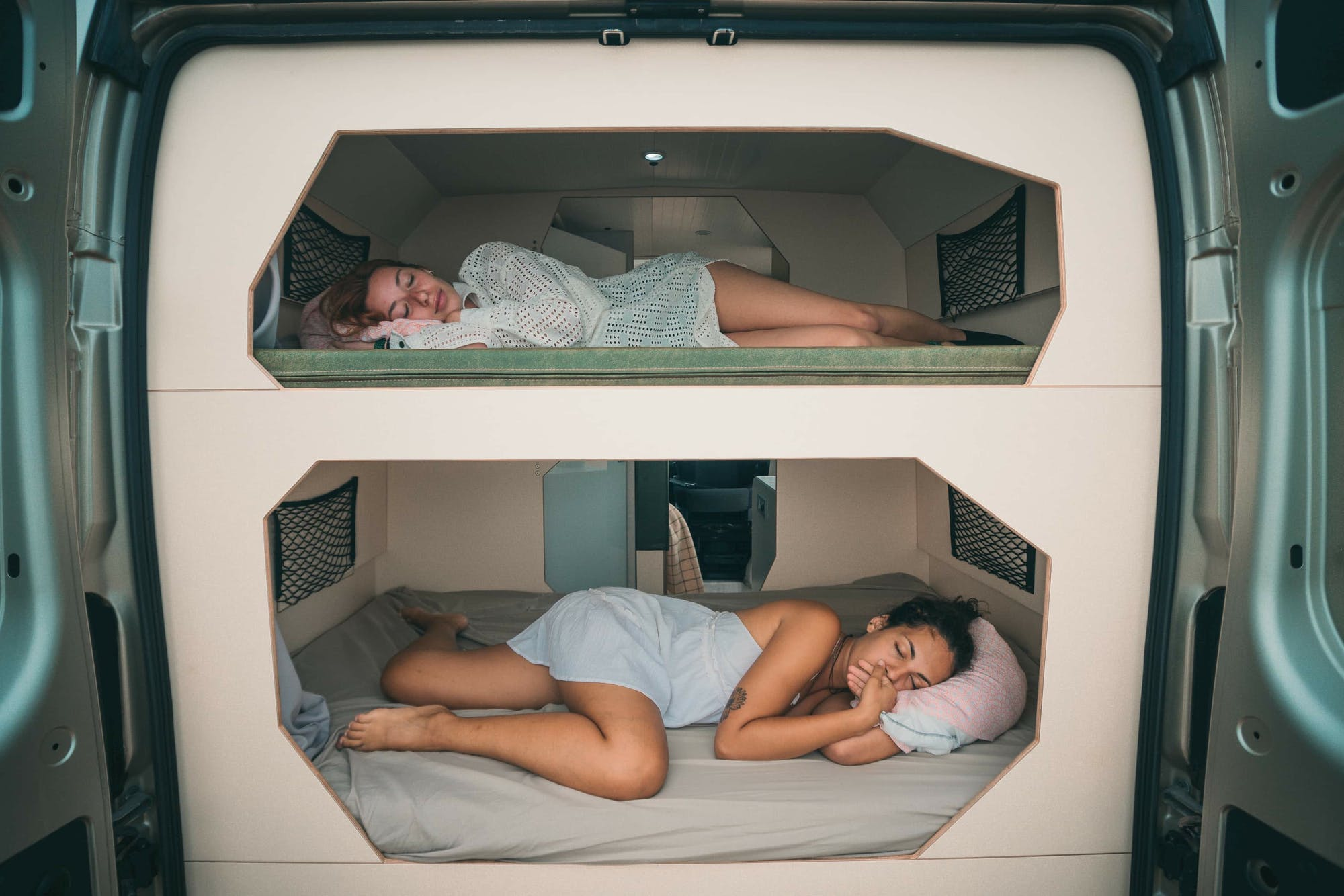 Two women each one on their own bed inside the Active Model