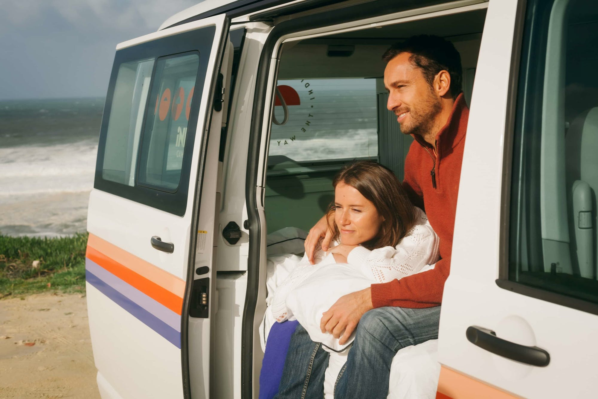 Couple enjoying the sun inside the VW California Model