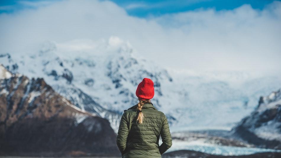 A traveller enjoying a mountainous view