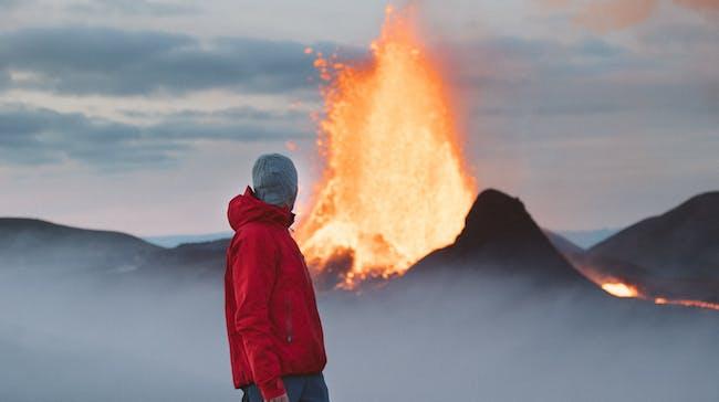 Traveller enjoying the eruption at Geldingadalir