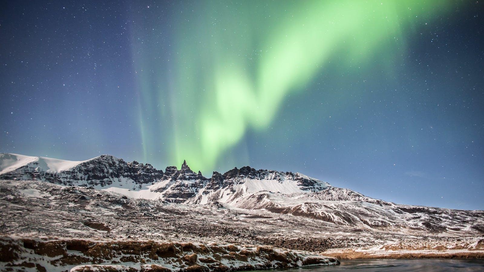 The Northern Lights make an appearance over the Jökulsarlón glacier lagoon.