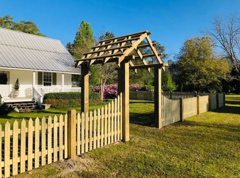 Cooper  Fence  Co.  wooden  fence