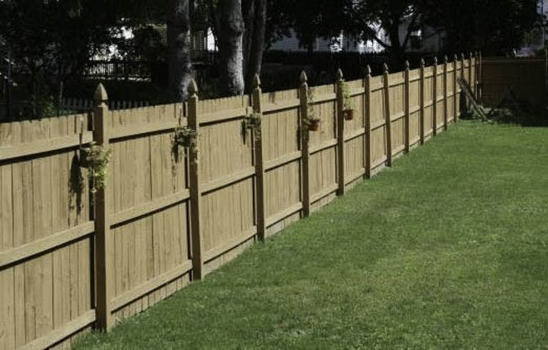 Excel Fence Inc. Wooden Fence