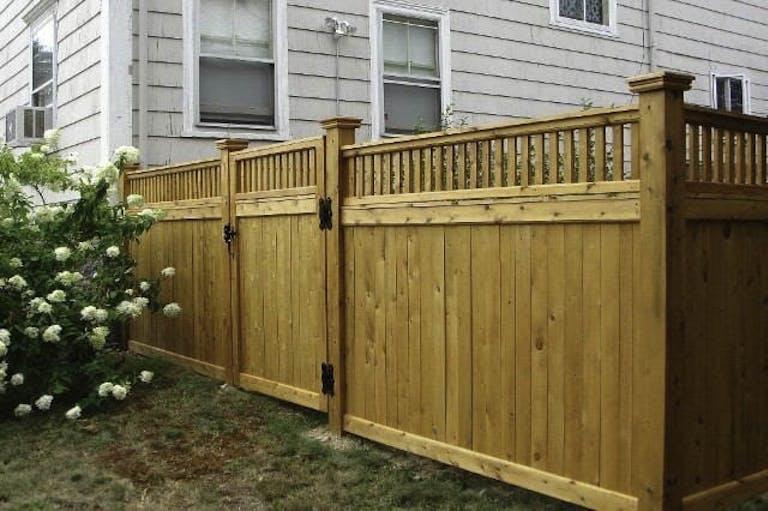 Precision Fence Contractors  Inc. Wooden Fence