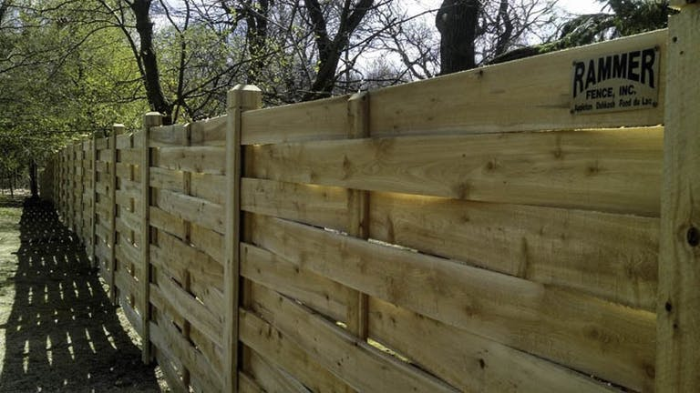 Rammer Fence Inc. Wooden Fence