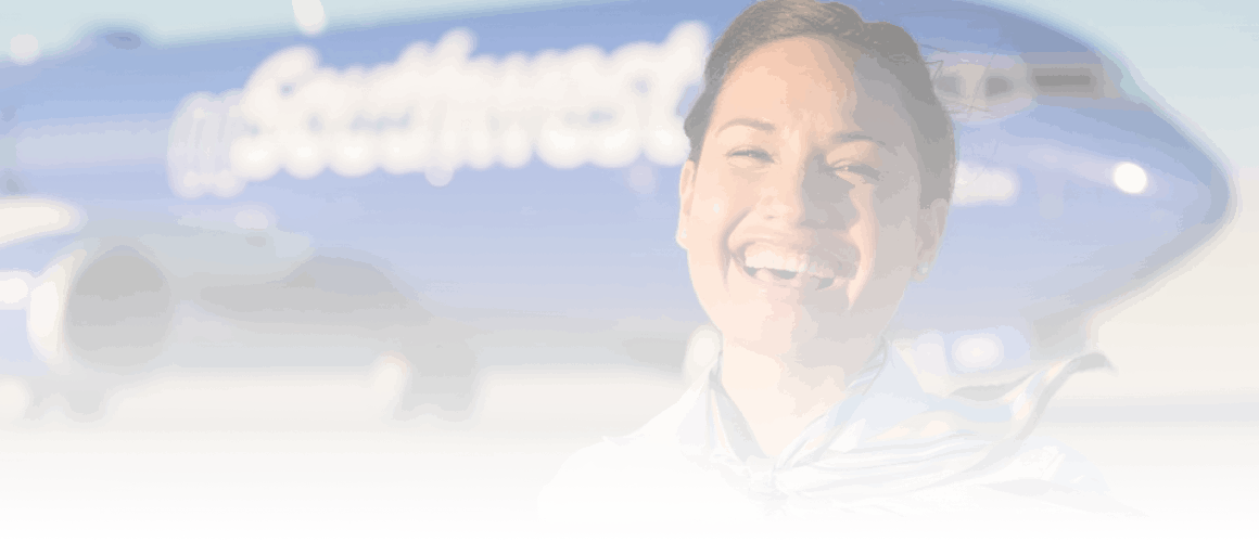 woman smiling in front of plane