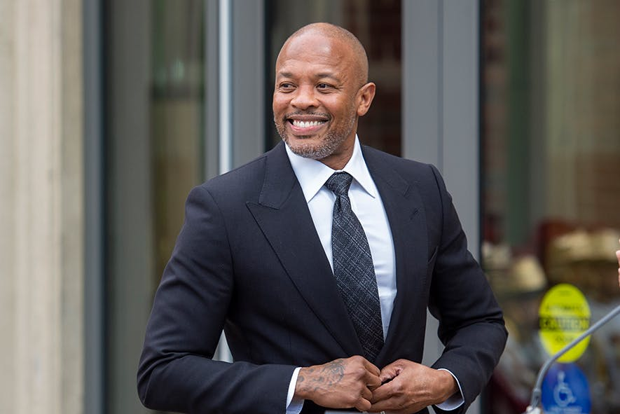 Man smiling in suit and tie