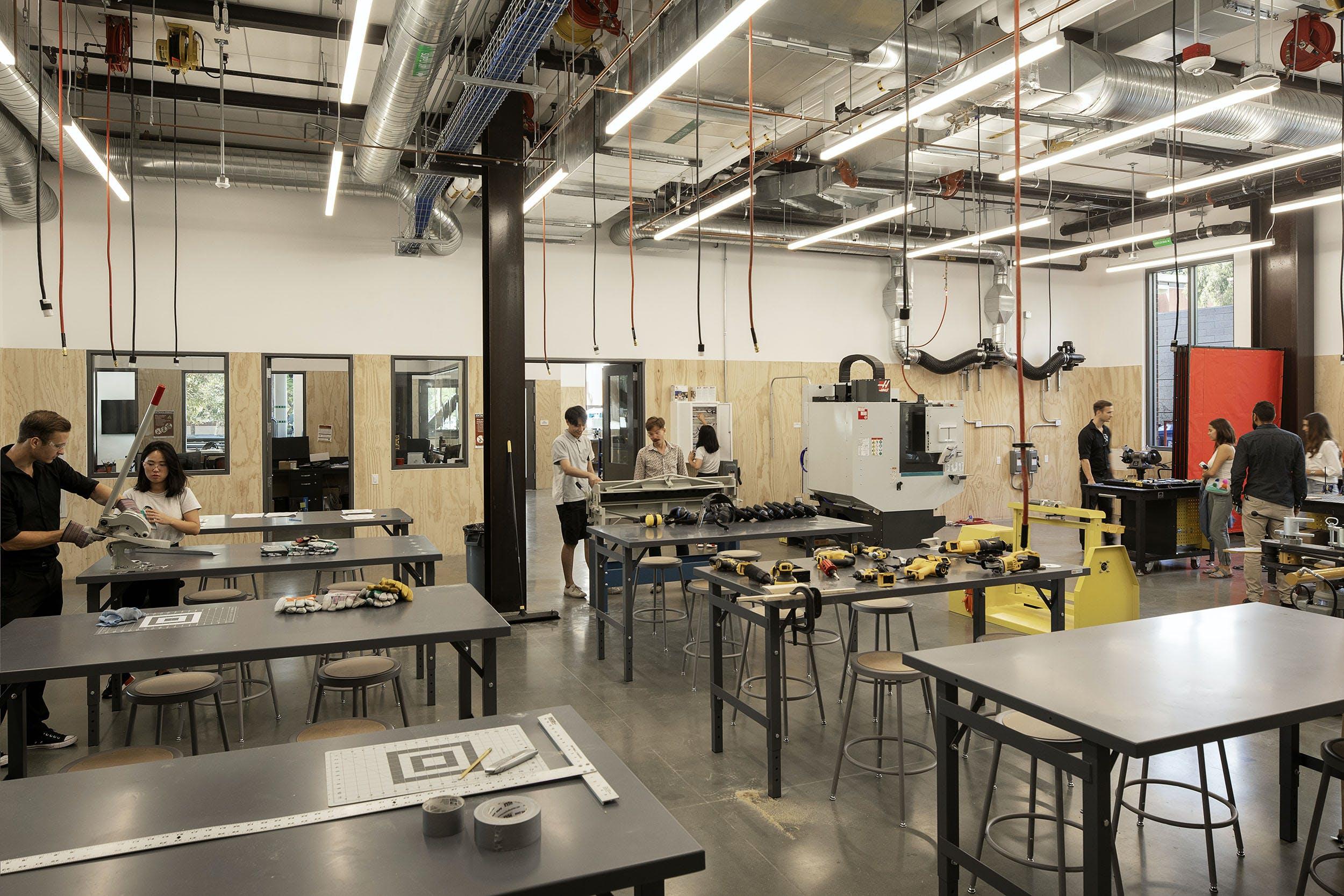 Students working in industrial workshop, makerspace