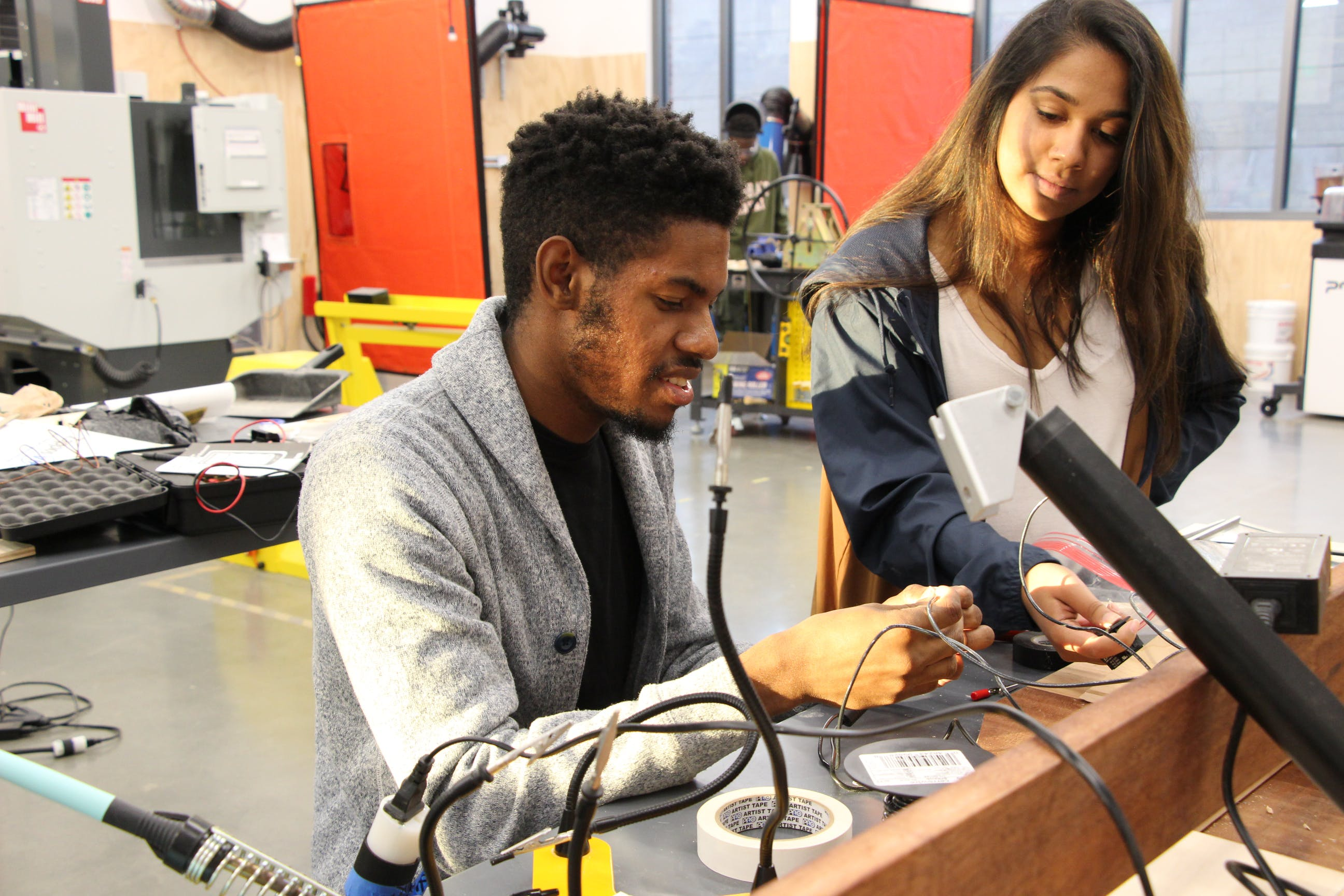 Two students at work bench