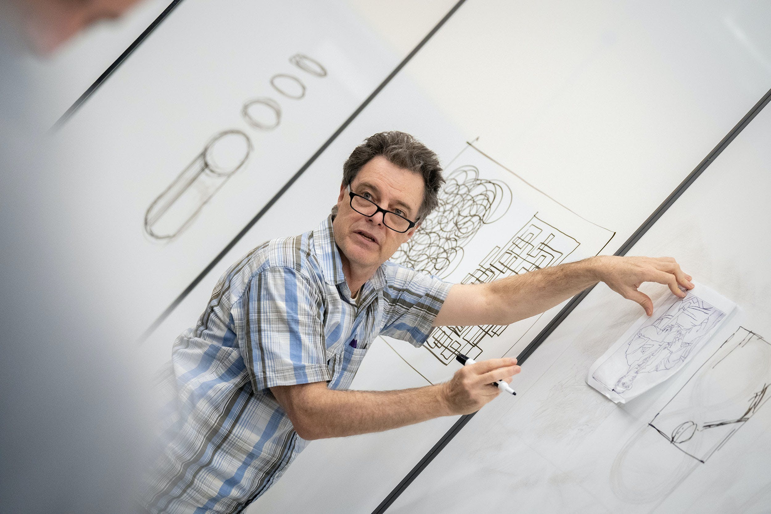 A faculty member is drawing for students
