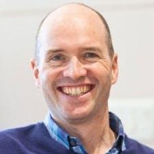 Headshot of smiling male