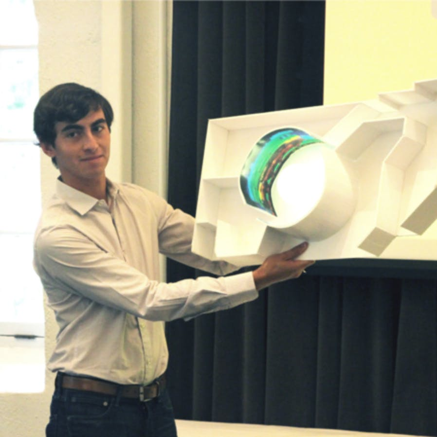 Male holding a cardboard prototype