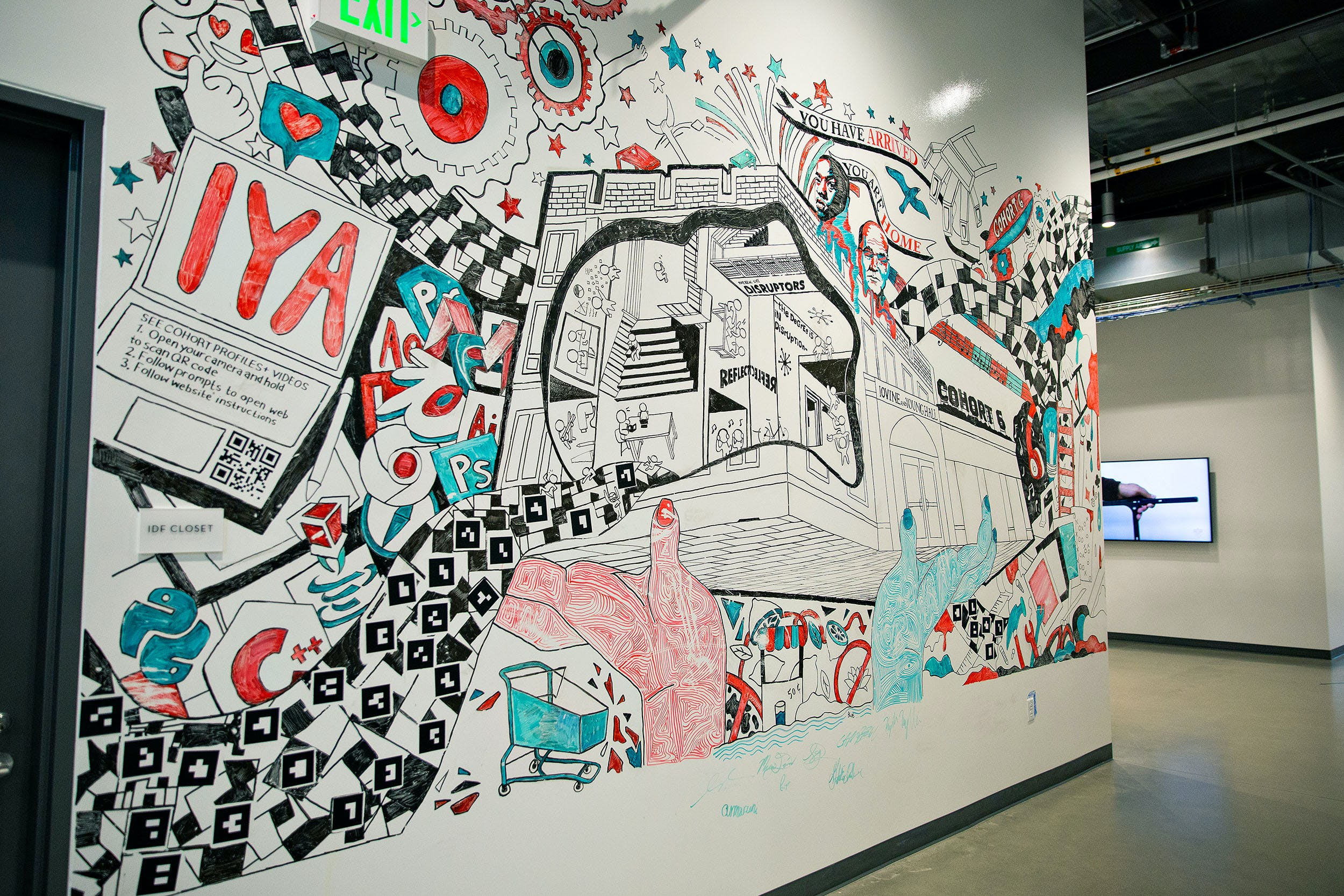 Vibrant mural with a collage of different images in red, black, white and green