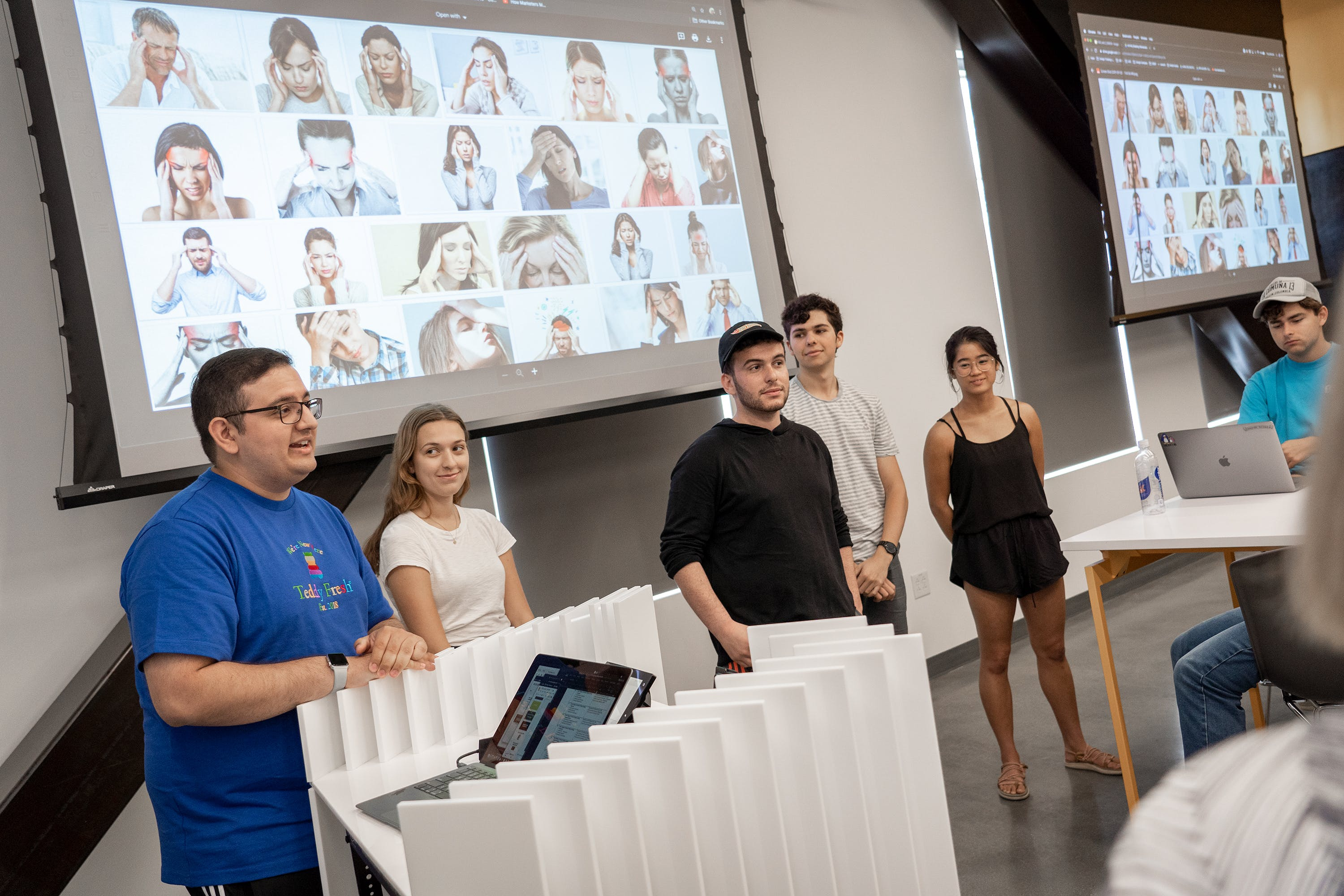 students presenting in front of group