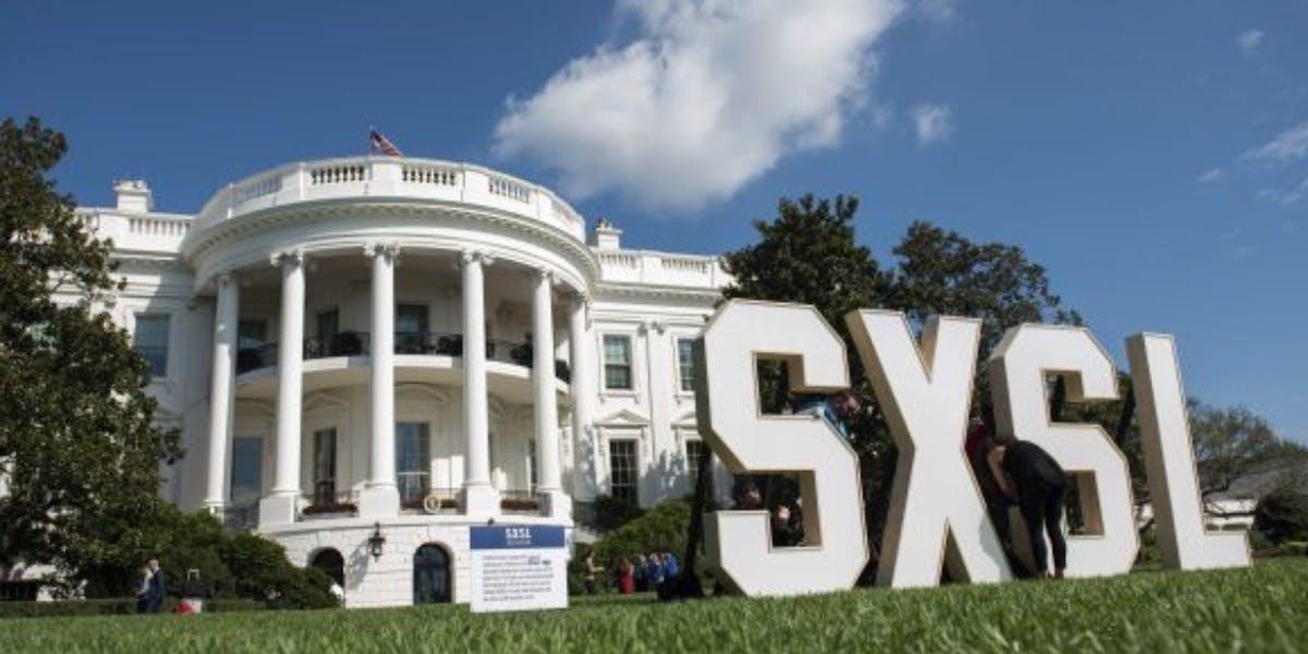 White house next to SXSL signage