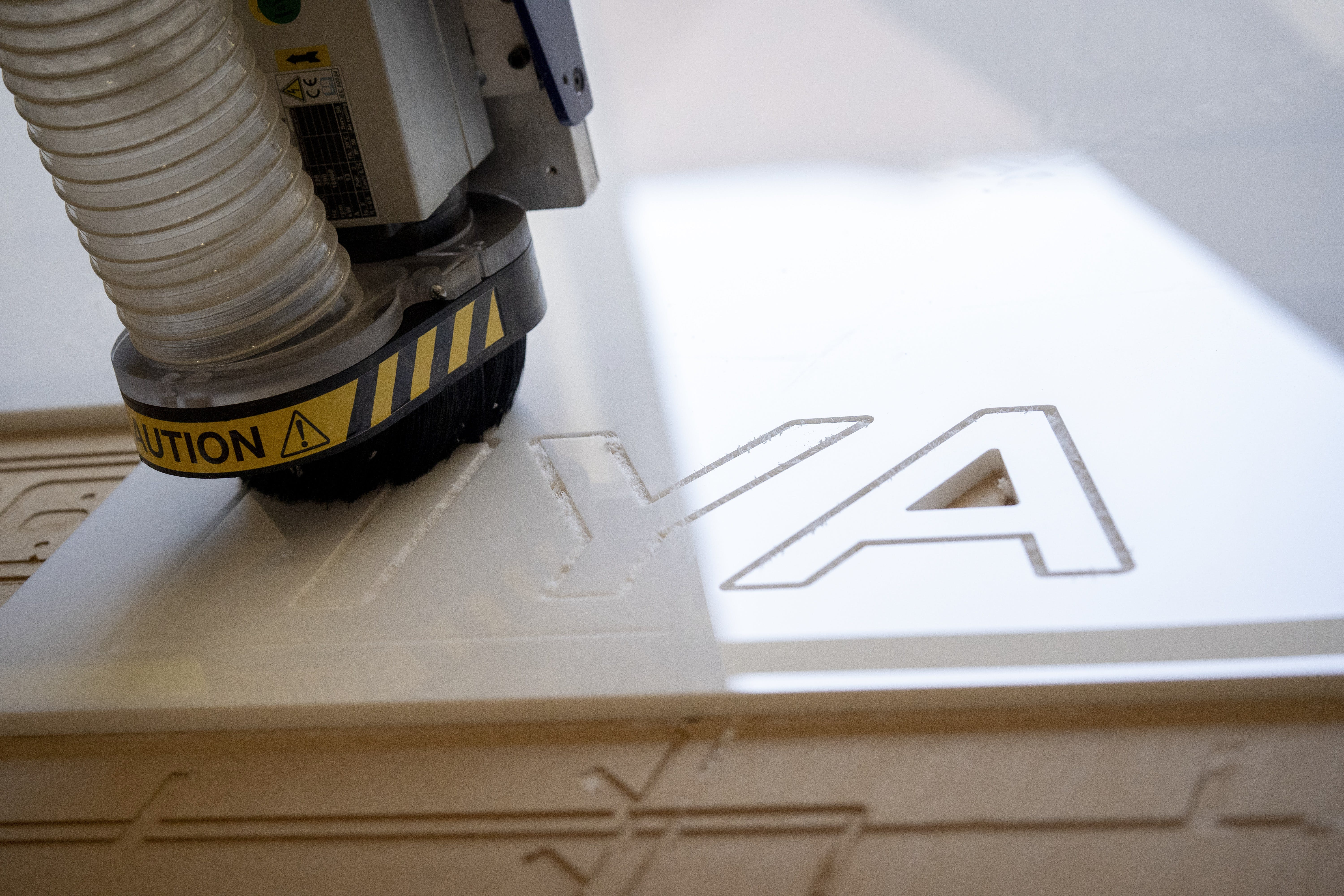 CNC Machine spelling out IYA in a material