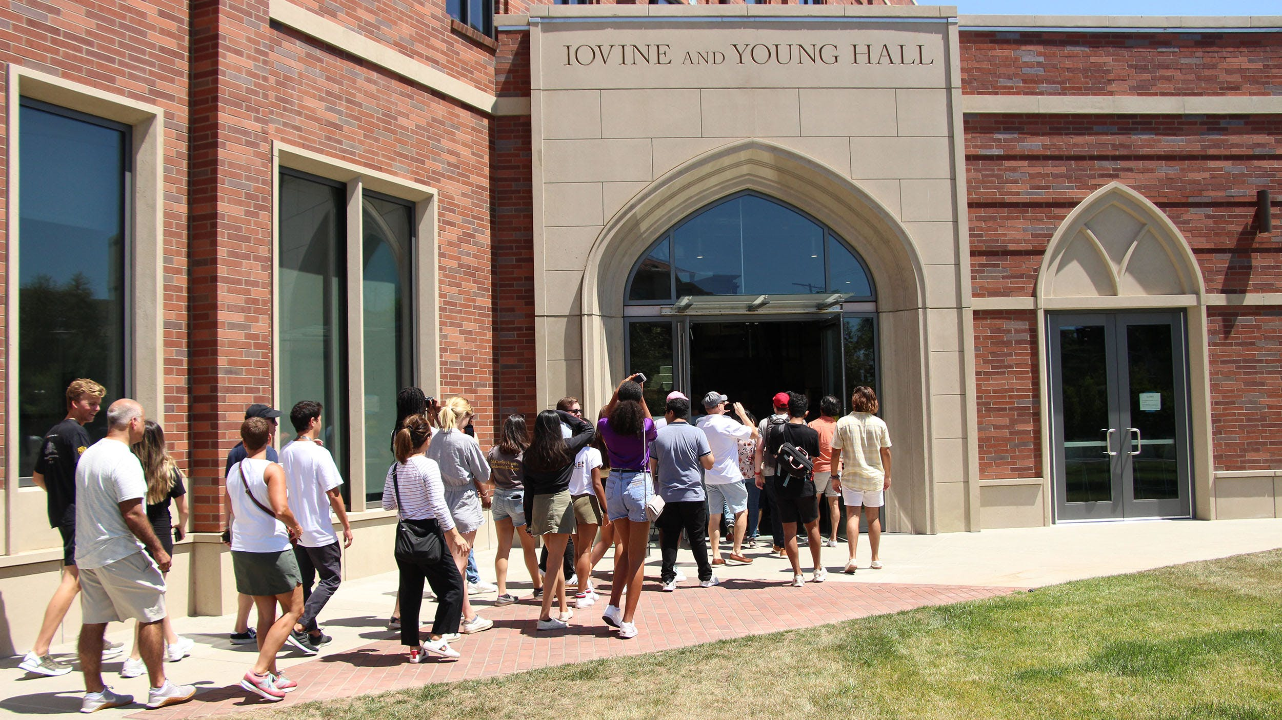 A tour walking into Iovine and Young Hall