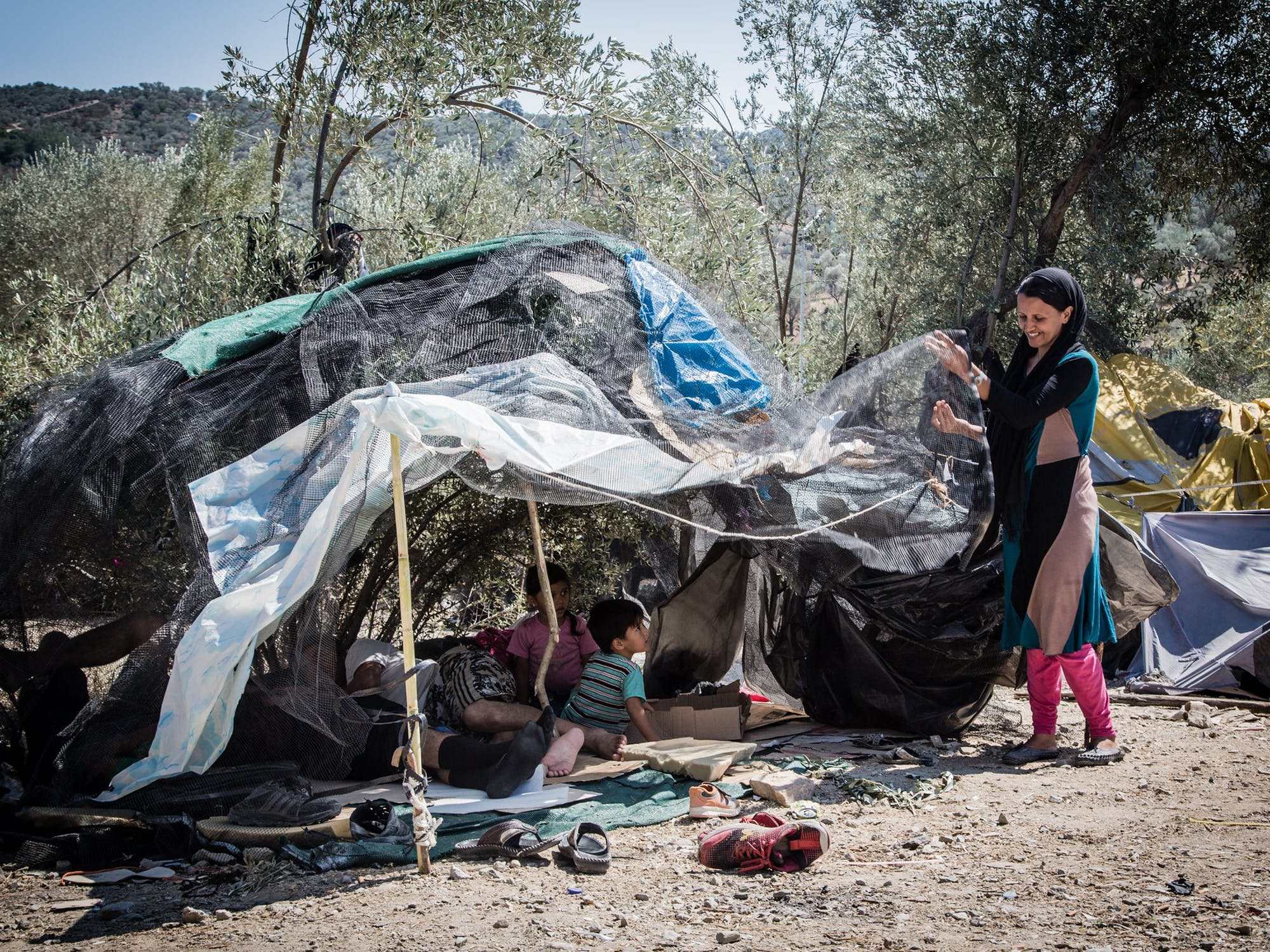 Woman standing by tent in Lesbos, Greece