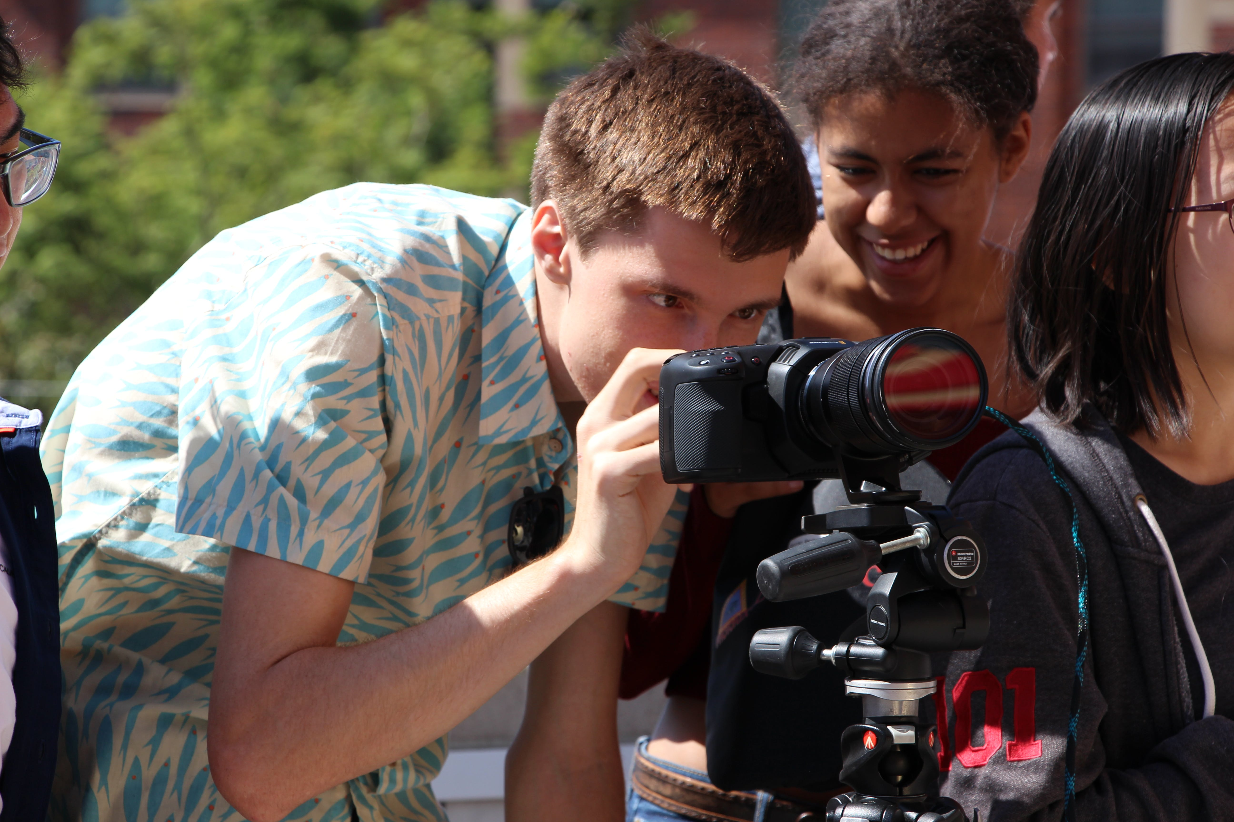 Students looking into a camera