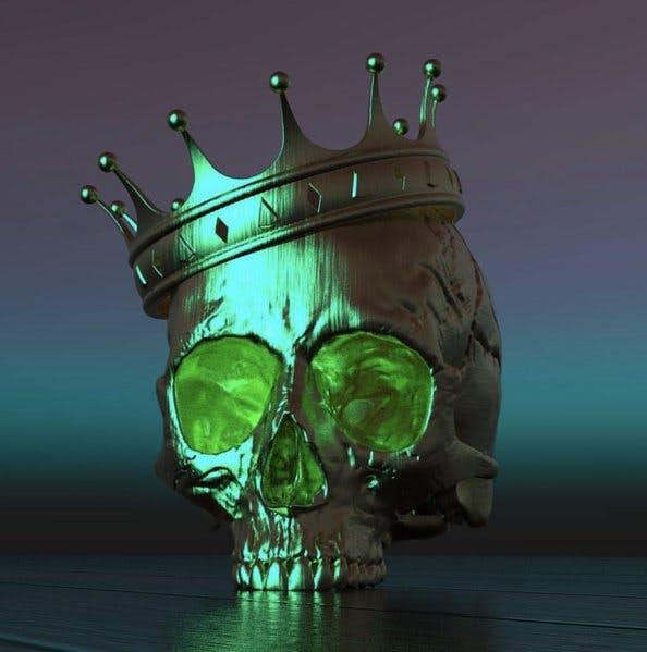 A green metallic skull wears a matching crown