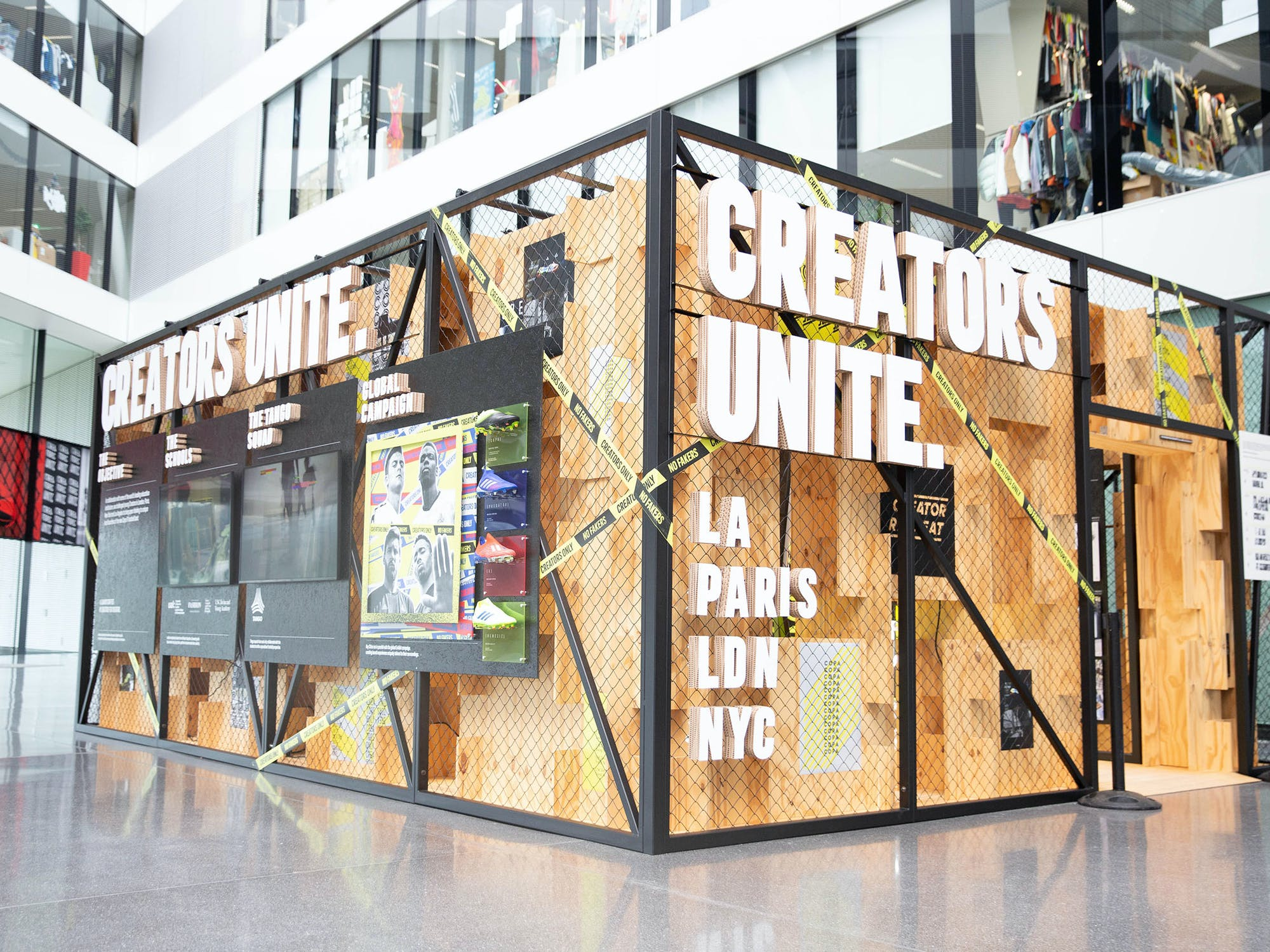 Indoor installation made of wood and steel with sign Creators Unite.