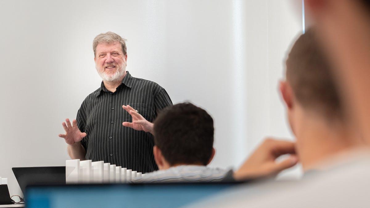 Male professor teaching students