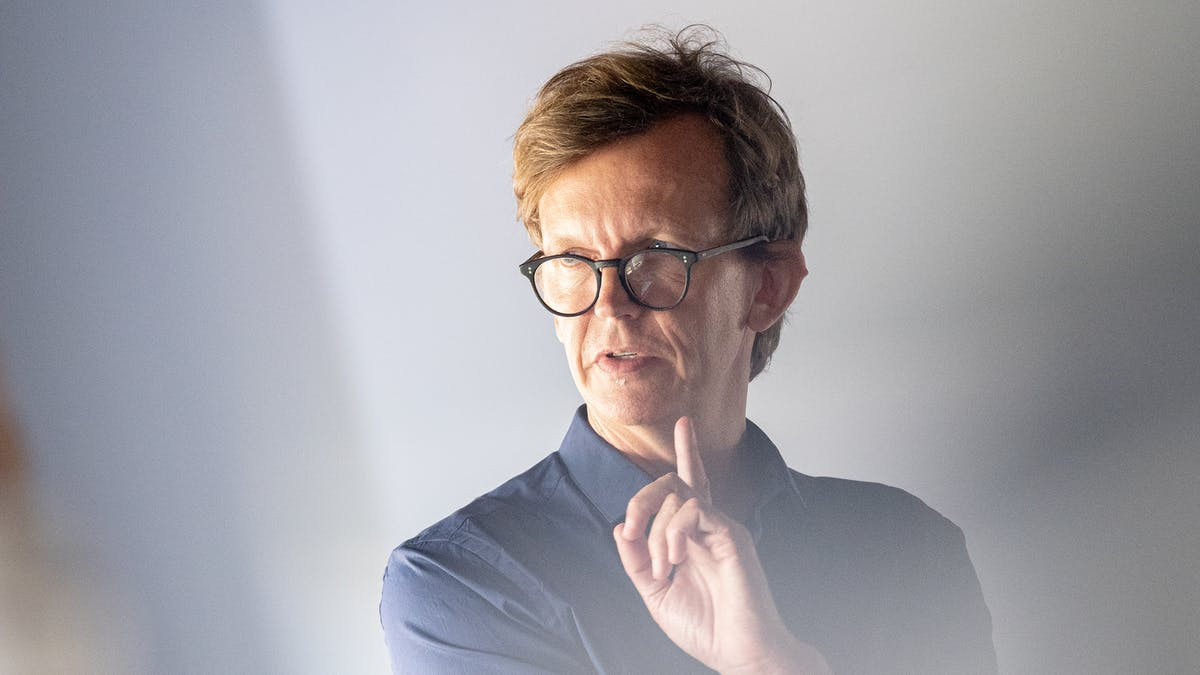 Professor with glasses pointing