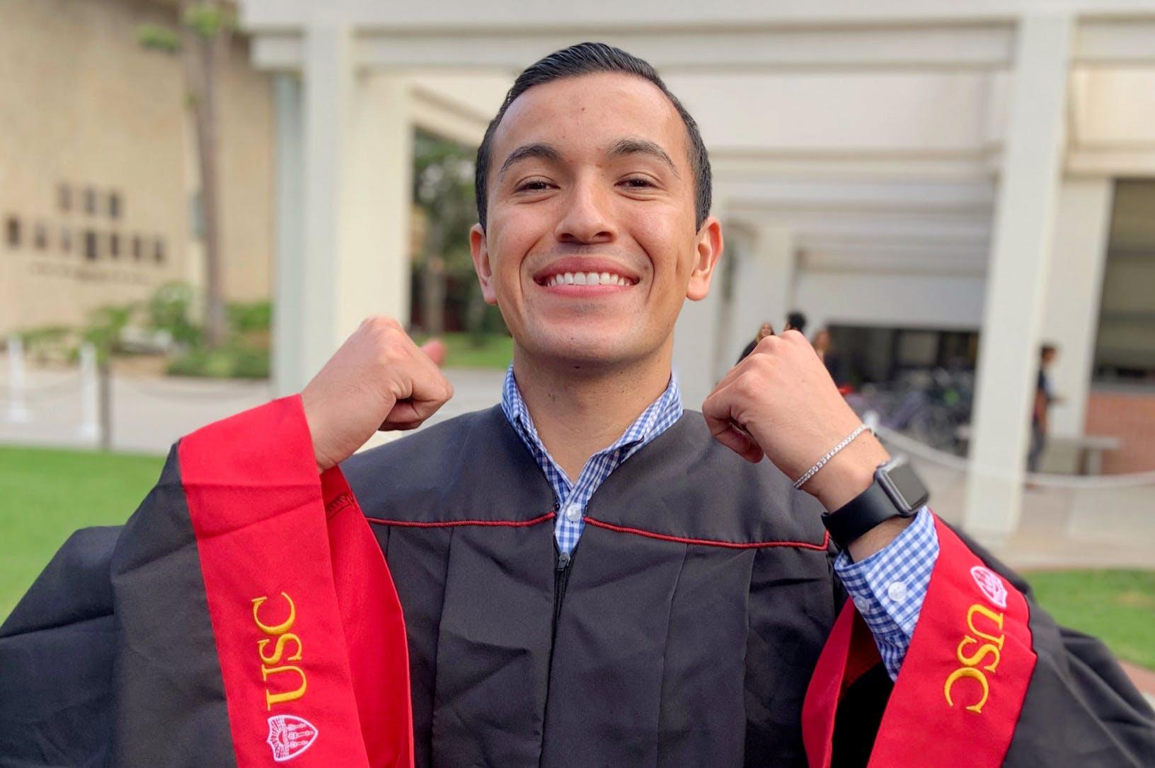 Graduating male smiling