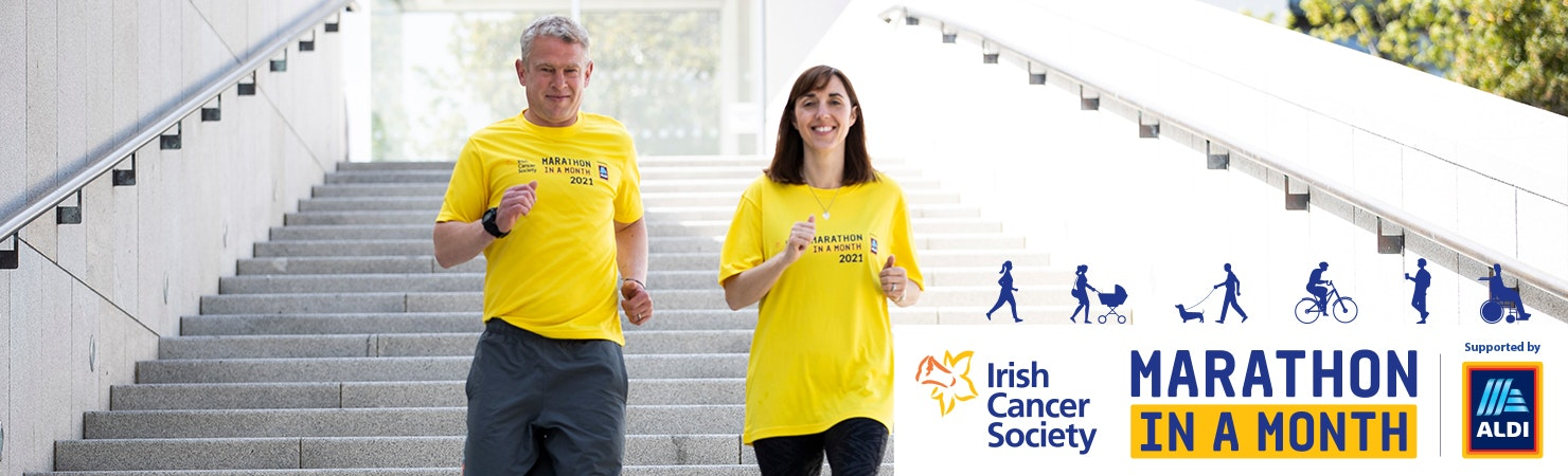 Irish Cancer Society Marathon in a Month - two people walking down stairs in yellow tops