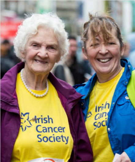 Two ladies smiling towards the camera in Irish Cancer Society t-shirts