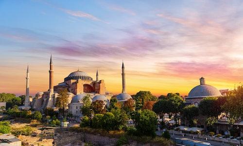 A mosque against a setting sun.