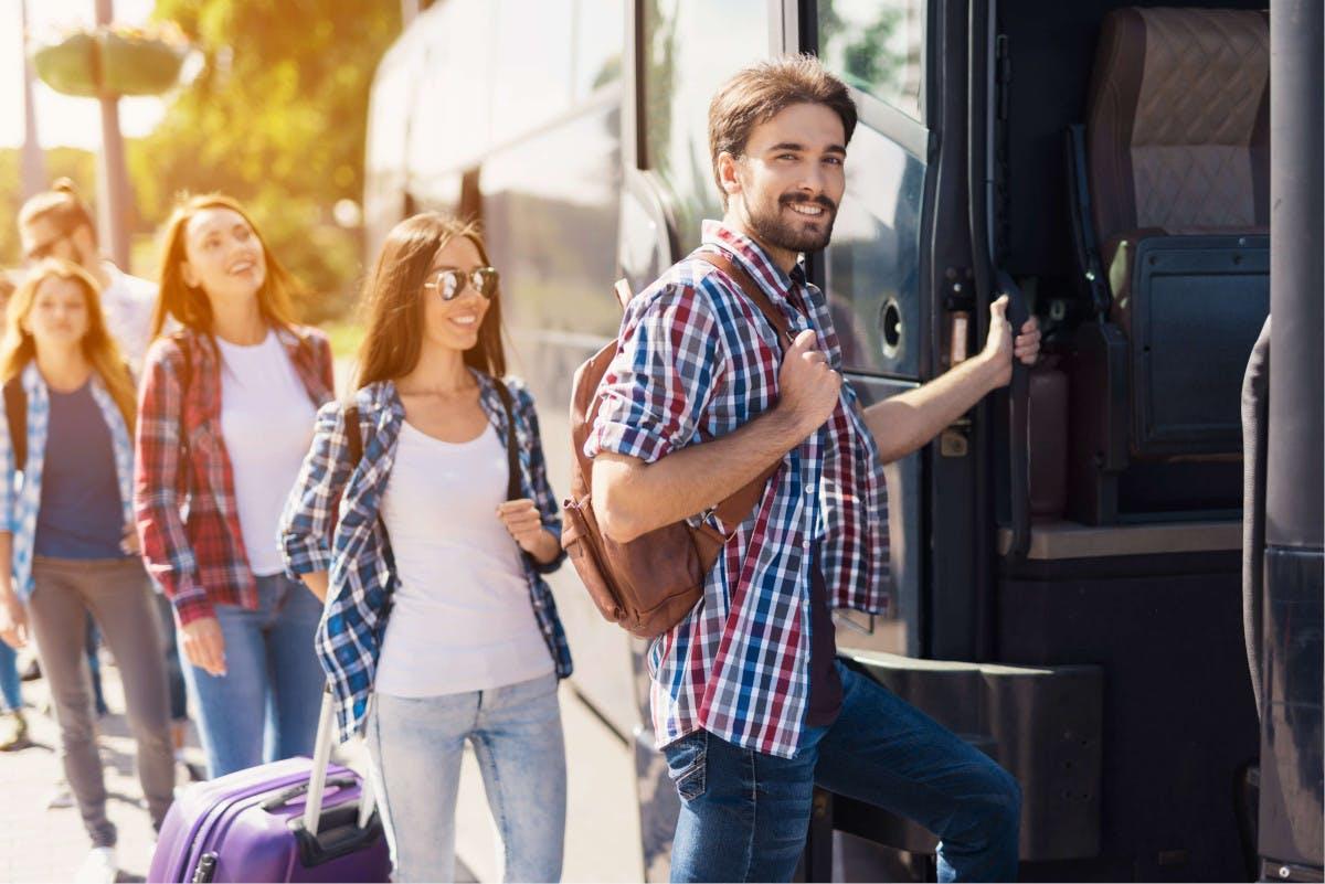 People enter bus