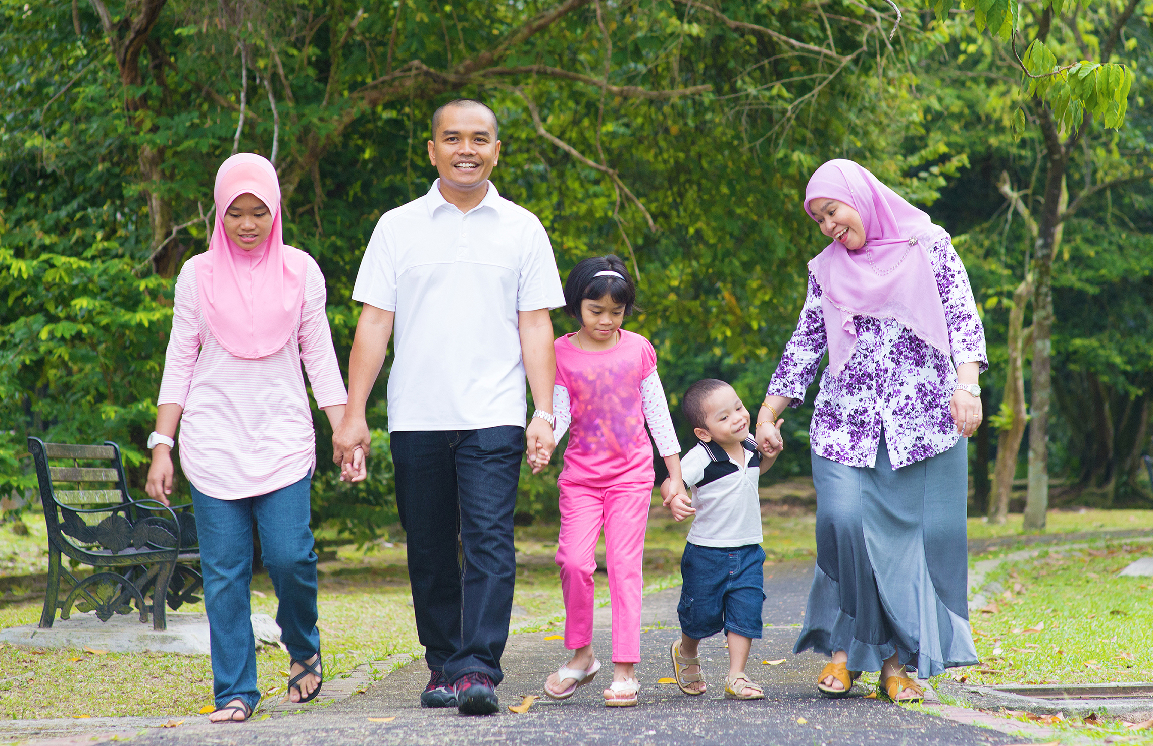 Image of a family walking together outside