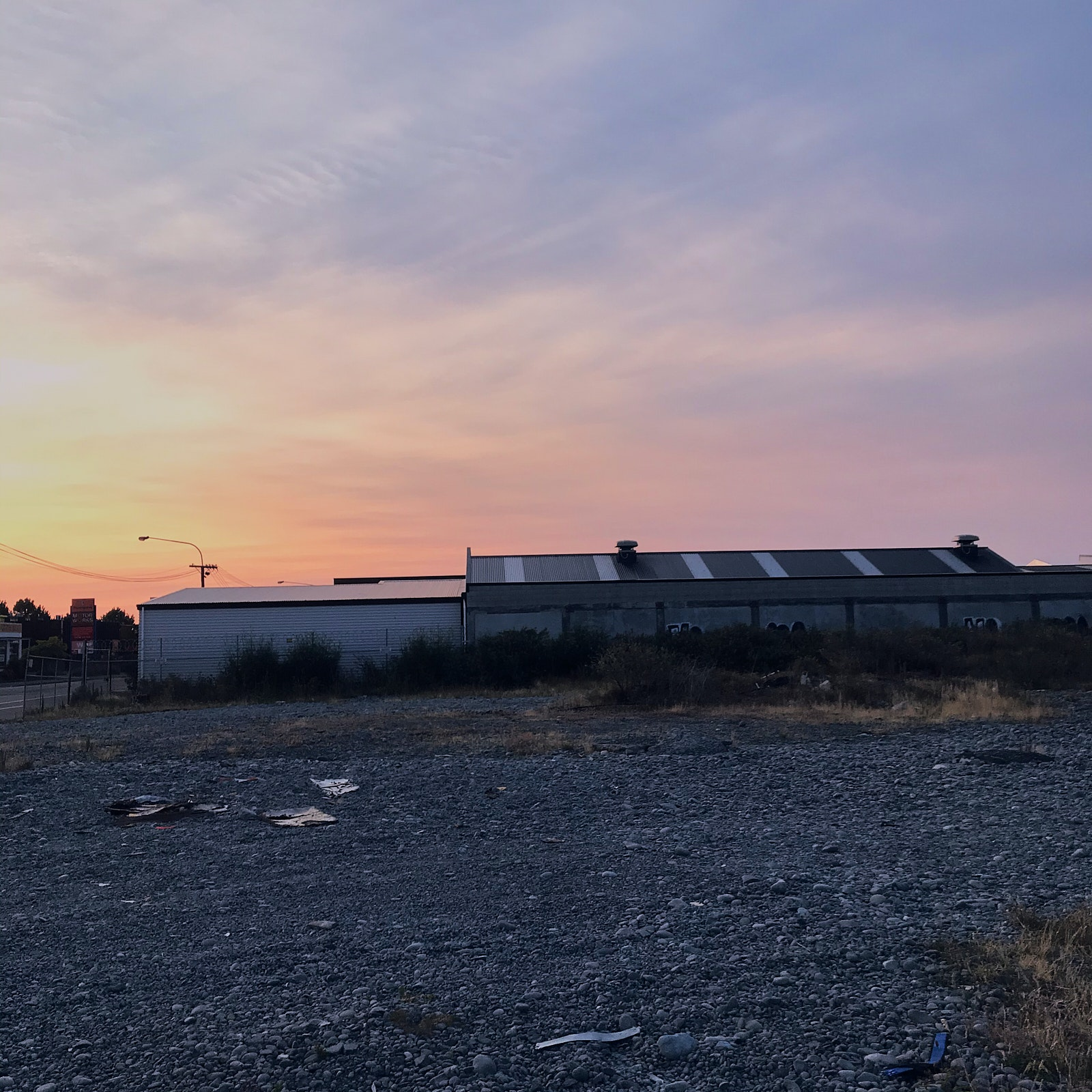 Sunset in a gravel lot.