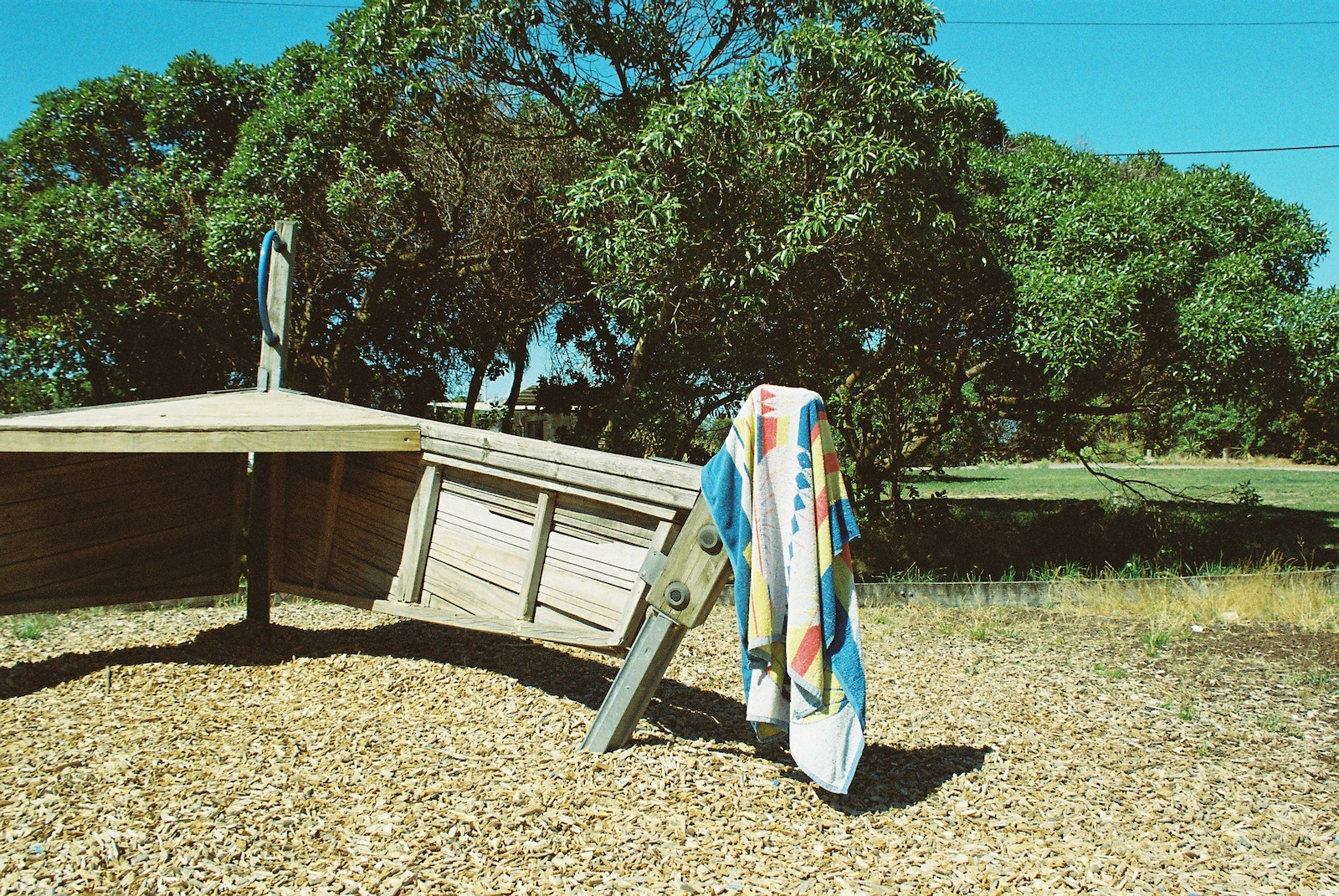 A towel hanging off some playground equipment