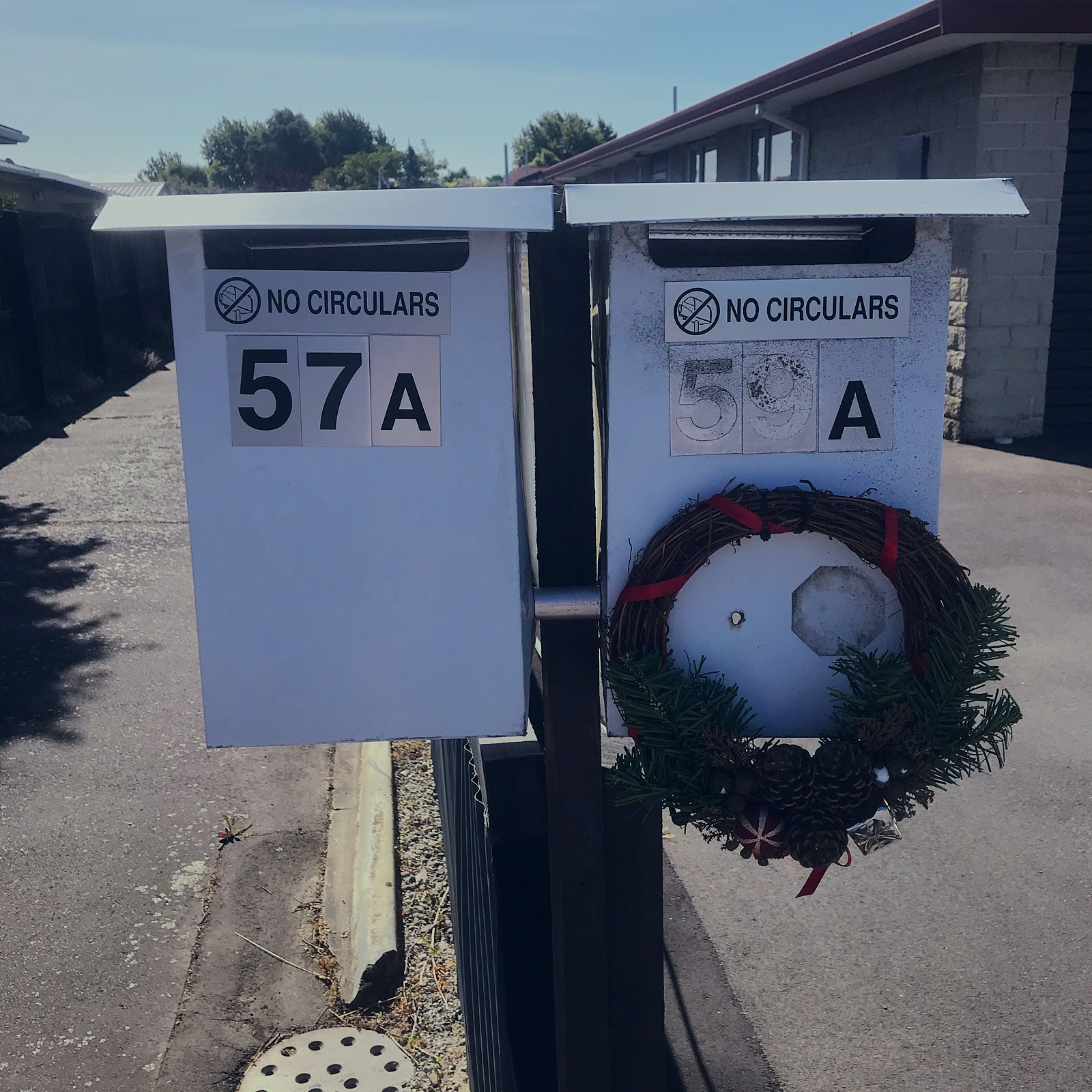 Two letterboxes, one with a wreath