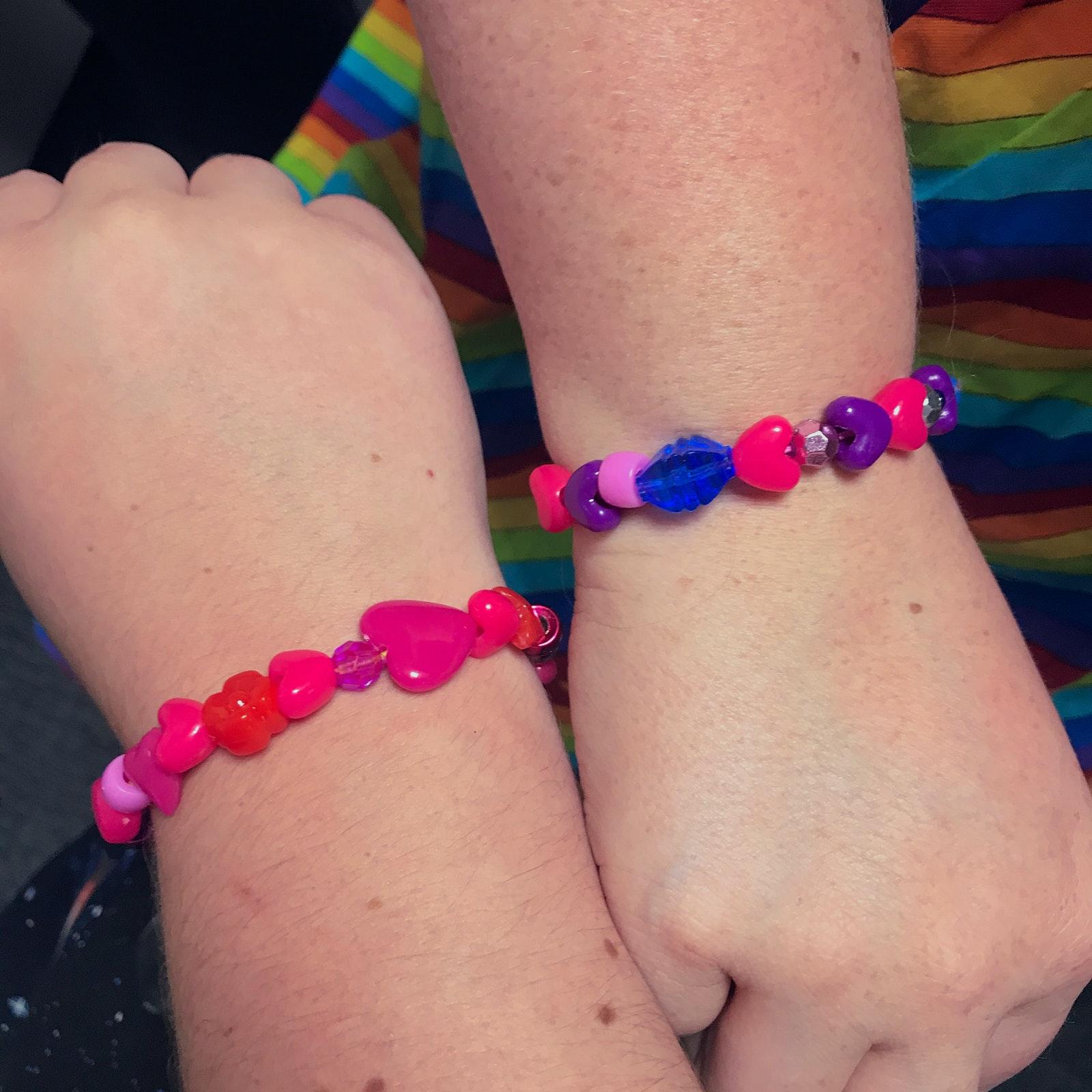 Two bracelets on two wrists