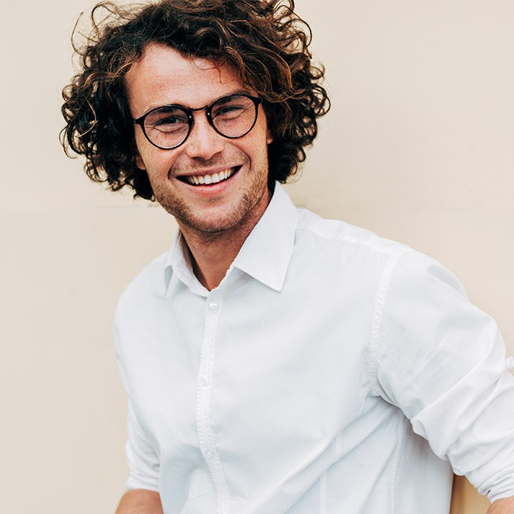 young man with glasses long hair