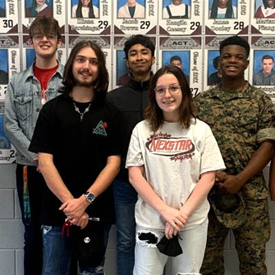 Horn Lake juniors recognized for ACT improvements. Back row, from left: Interim Principal Paul Chrestman, Jacob Brown, David Flores, X'Zorion Piere, and Assistant Principal Mazie Lamb. Front row, from left: Dakota Ross and Graycie Pegram.