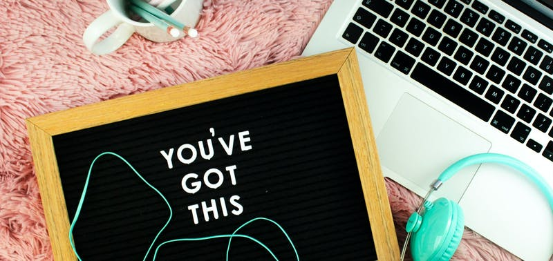A Laptop, headphones and pencil pot with a chalkboard saying you've got this - a photo by Emma Matthews Digital Content Production