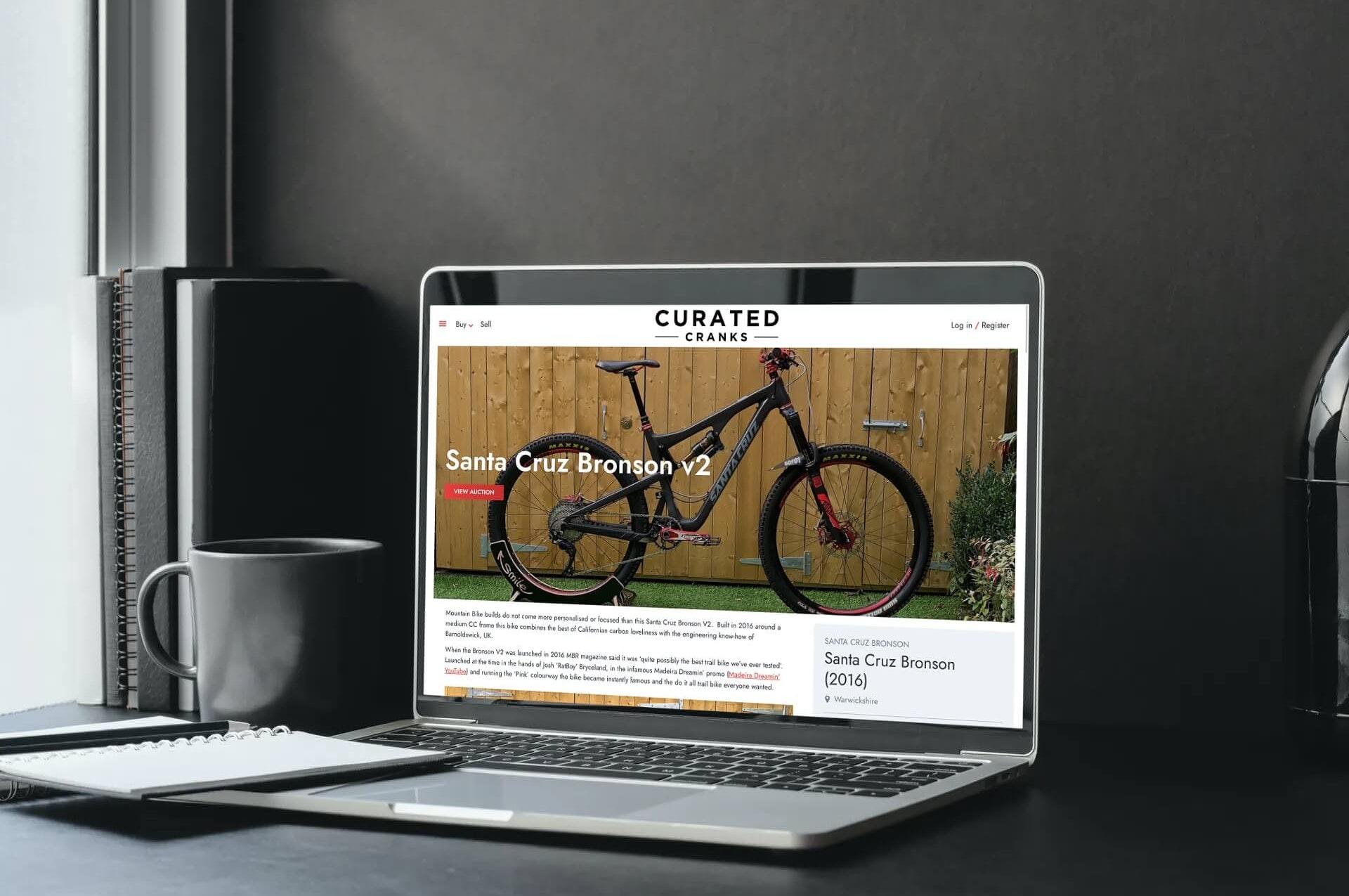 curated cranks website displayed laptop